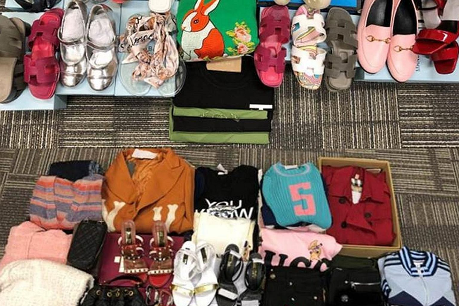 Over 500 pieces of fake luxury goods such as footwear, watches and bags were seized in raids on seven retail outlets.