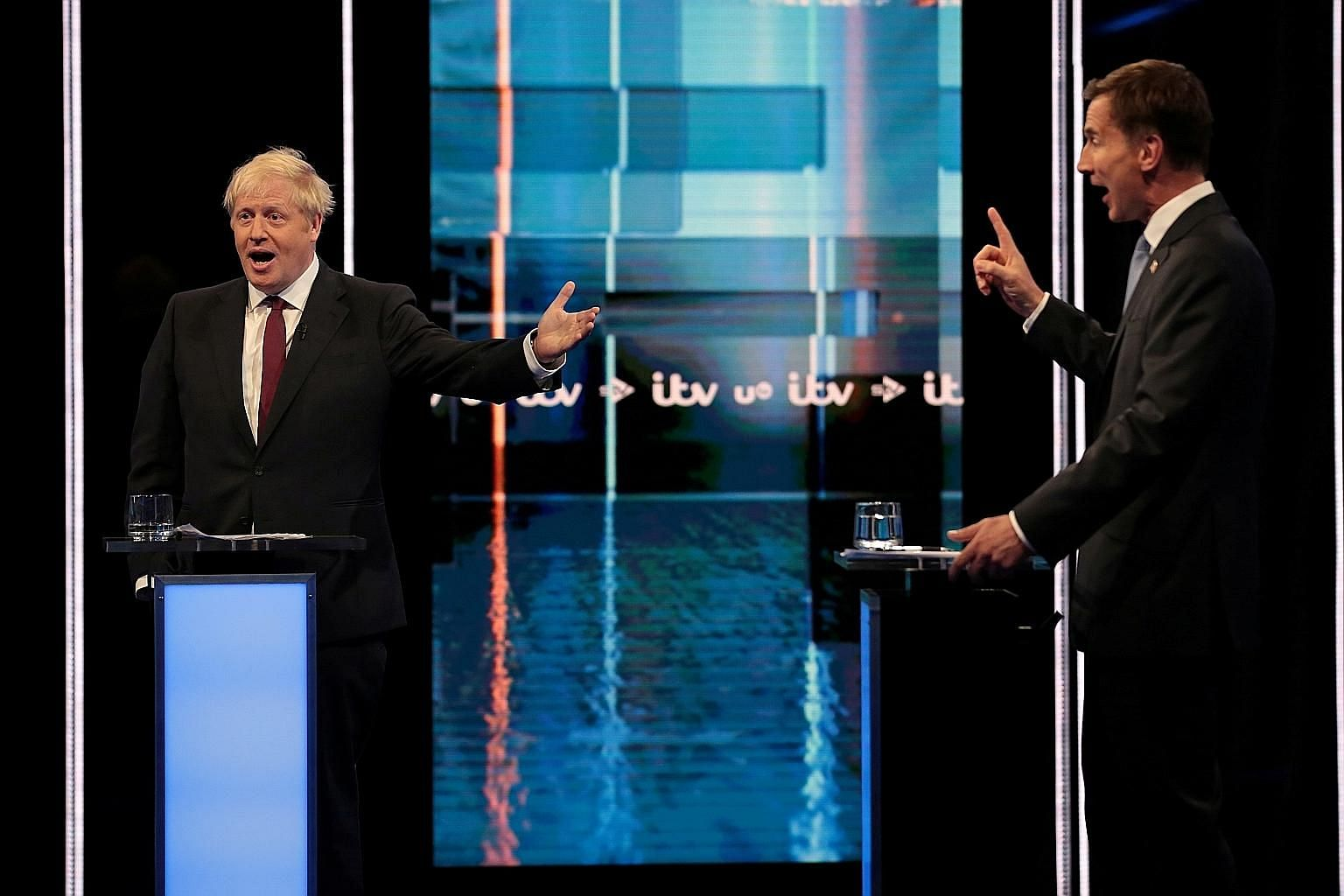 Mr Boris Johnson (left) questioned Mr Jeremy Hunt's commitment to leaving the European Union on Oct 31, while Mr Hunt criticised Mr Johnson for relying on what he said was nothing more than optimism to win a deal, in a TV debate just two weeks before