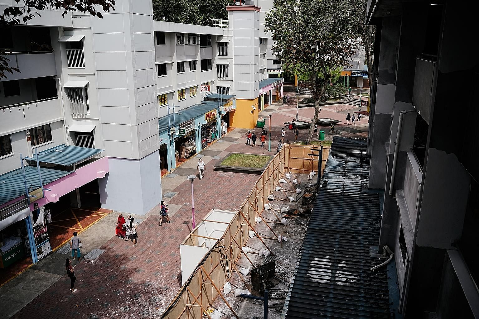 The four shops destroyed by the fire at Block 720 Ang Mo Kio Avenue 6 remain closed and the owners of those next door say business has been badly affected as some areas have been cordoned off.