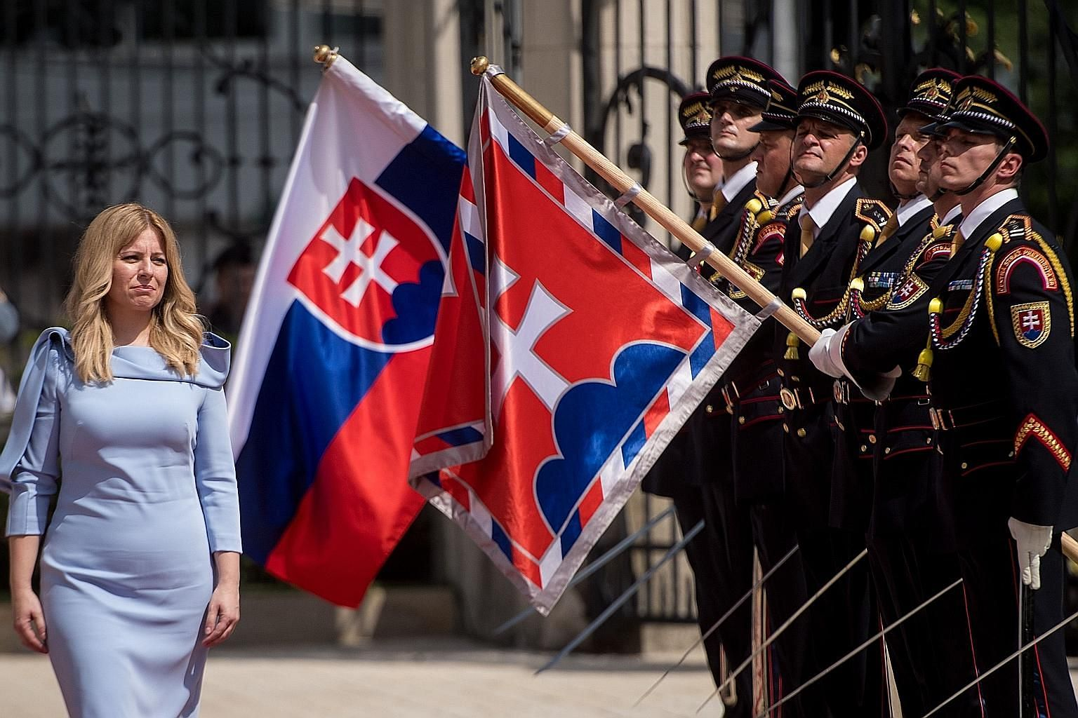 Slovakia's new President Zuzana Caputova reviewing a guard of honour as part of her inauguration in Bratislava last month. Ms Caputova's electoral victory is seen as part of a growing rejection of populism across Europe.