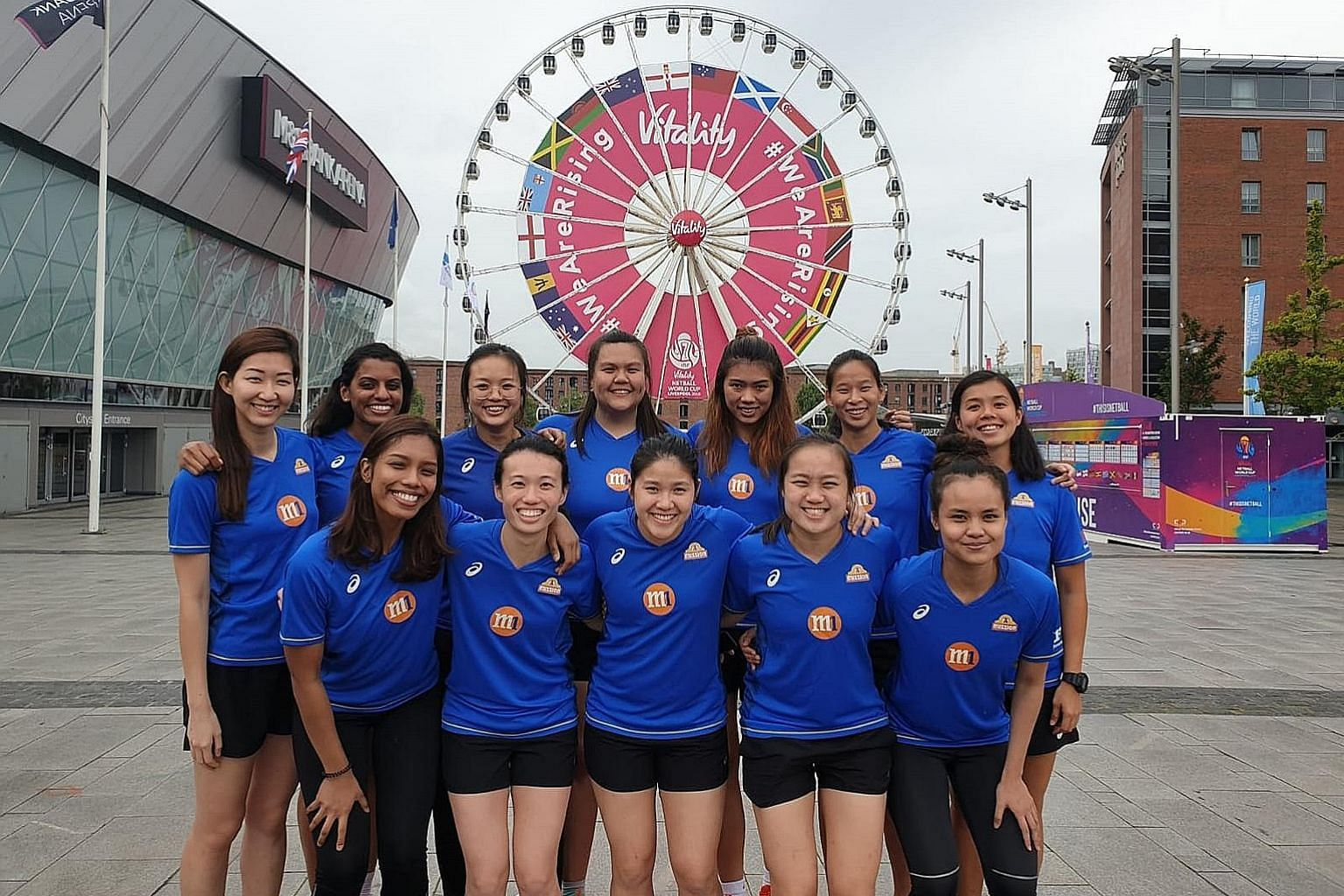 Charmaine Soh (back, left) and Kimberly Lim (front, centre), with teammates outside the Netball World Cup venue M&S Bank Arena in Liverpool, are the only two Singapore players with experience at this level.