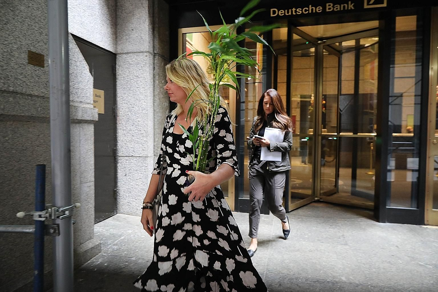 Deutsche Bank staff leaving the New York headquarters after being laid off on Monday. Disloyalty is so embedded at investment banks that the habit is hard to break for both employer and staff. Traders demand big bonuses and threaten to leave for high