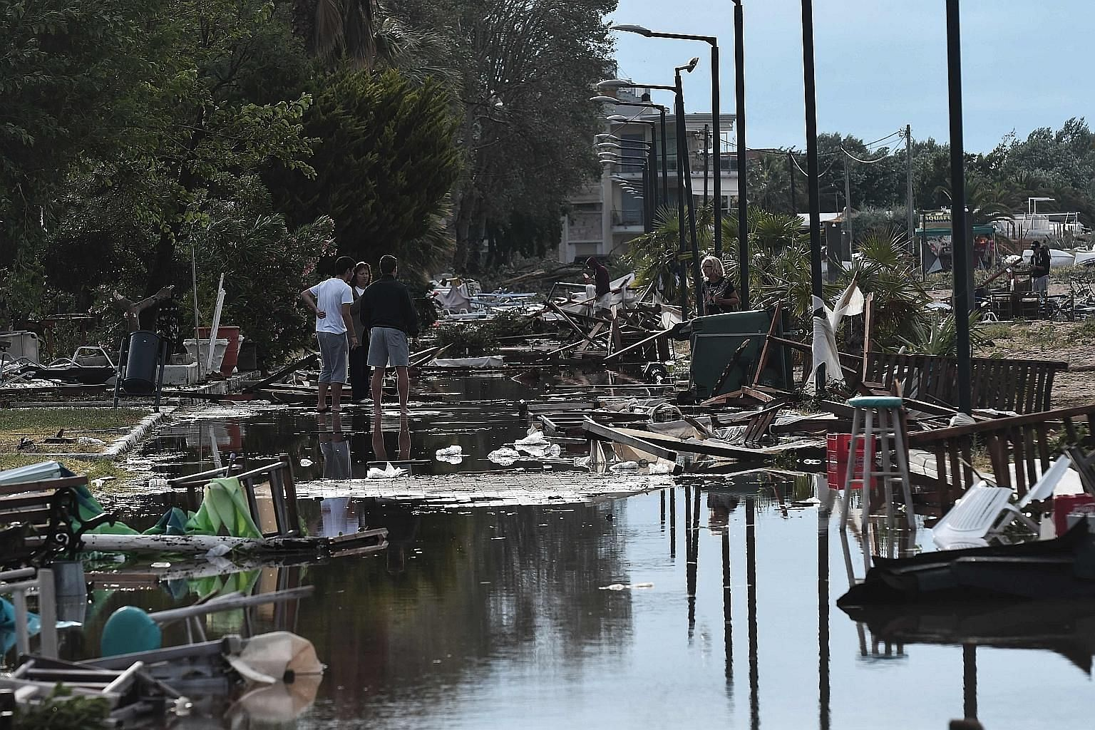 These beach bars in Chalkidiki, northern Greece, were destroyed by Wednesday's lashing storms. Officials have declared a state of emergency and army crews are working to restore electricity. PHOTO: AGENCE FRANCE-PRESSE