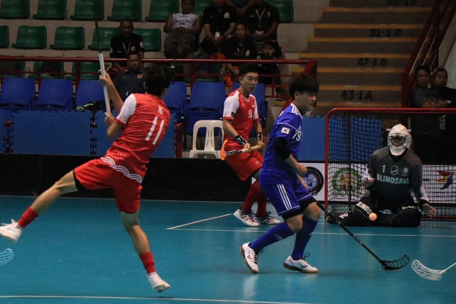 Singapore's Ng Juin Jie (No. 11) taking a shot against South Korea in the semi-finals of the men's Asia Oceania Floorball Confederation Cup in Binan, Philippines yesterday. The Republic won 13-1 to progress to today's final with Thailand, who beat th