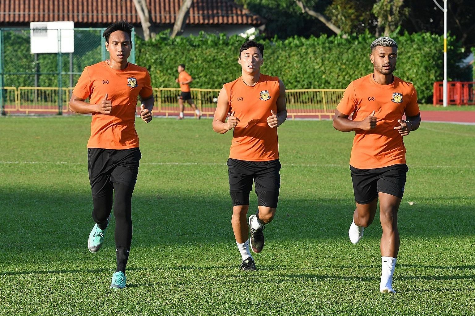 Hougang United players (from far left) Afiq Yunos, Kong Ho-won and Paulin Mbaye training on Thursday ahead of today's match against Albirex at Jurong East.