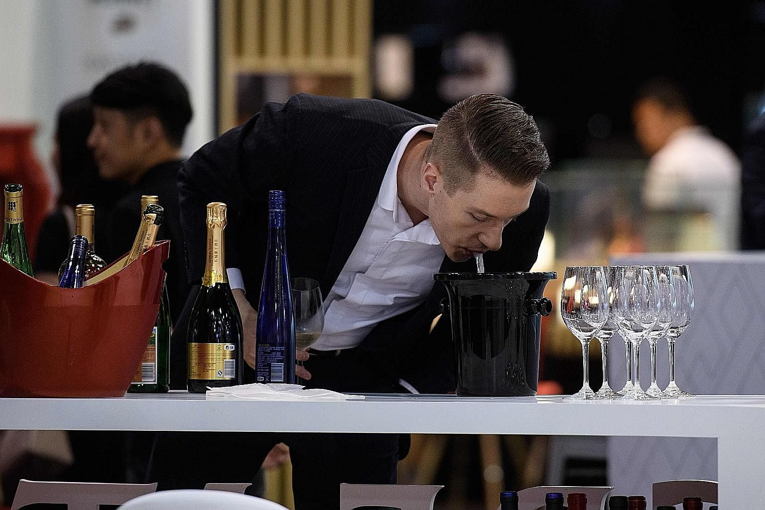 """Spitting when tasting wine can bring out """"other prevalent aromatic notes"""" when it mixes with air coming from the nose, says Mr Pierre-Jules Peyrat, a Paris sommelier."""