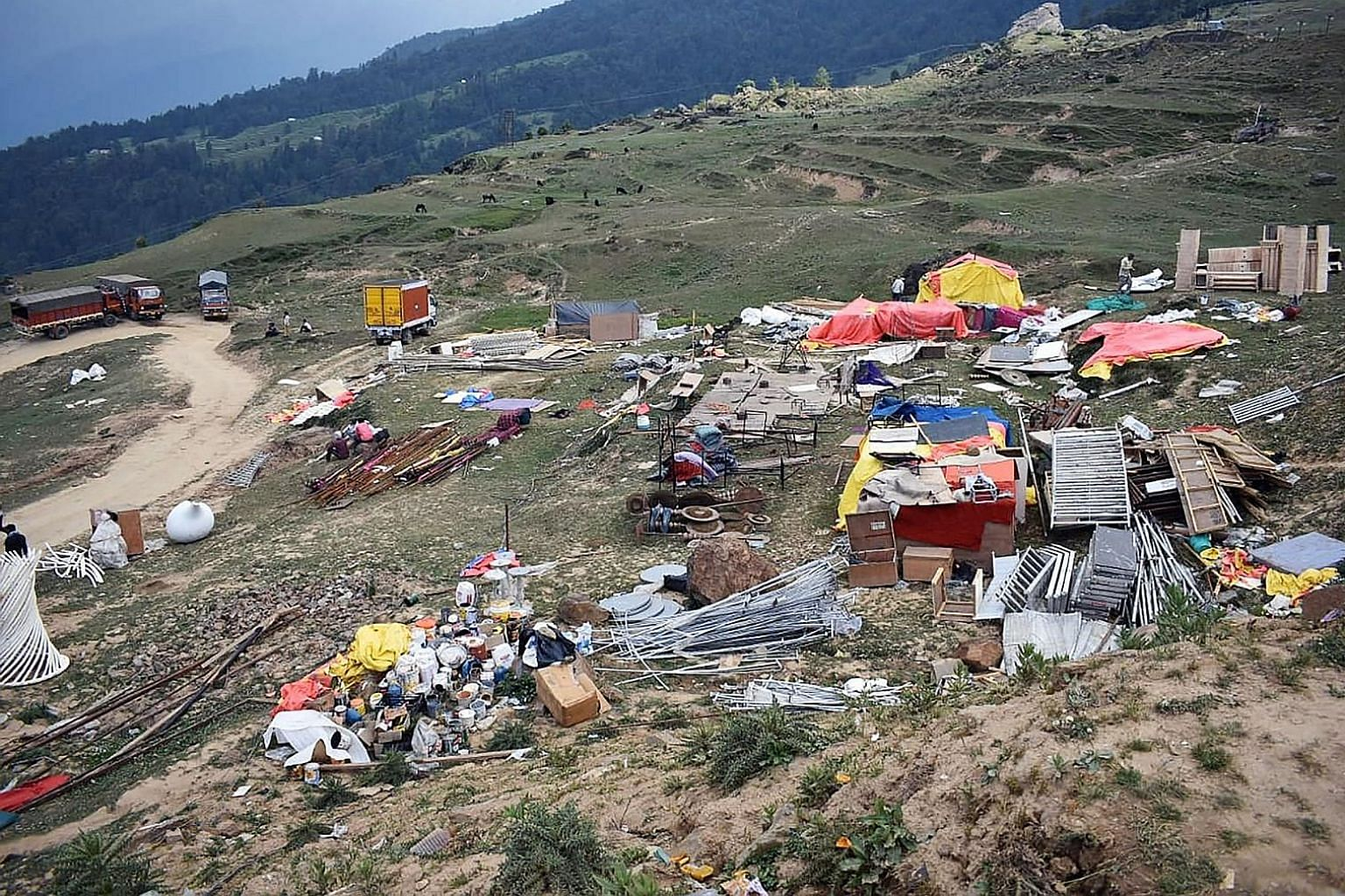 The Gupta family wanted the weddings (top) to be held between the Nanda Devi mountain and Kedarnath (above) and Badrinath temple towns. Rubbish littering a venue in Auli, Uttarakhand, on June 24, days after the large-scale weddings of two scions from