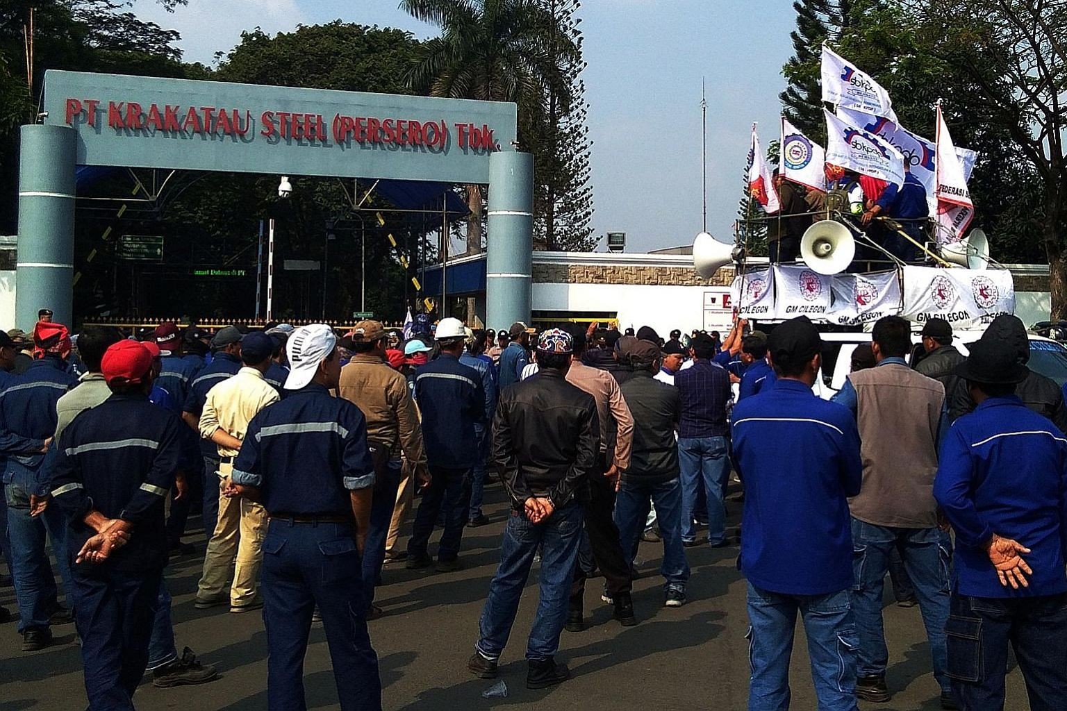 Krakatau Steel workers protesting last week outside their plant in Cilegon, Indonesia, against the company's plans for a 30 per cent cut in the workforce. PHOTO: REUTERS