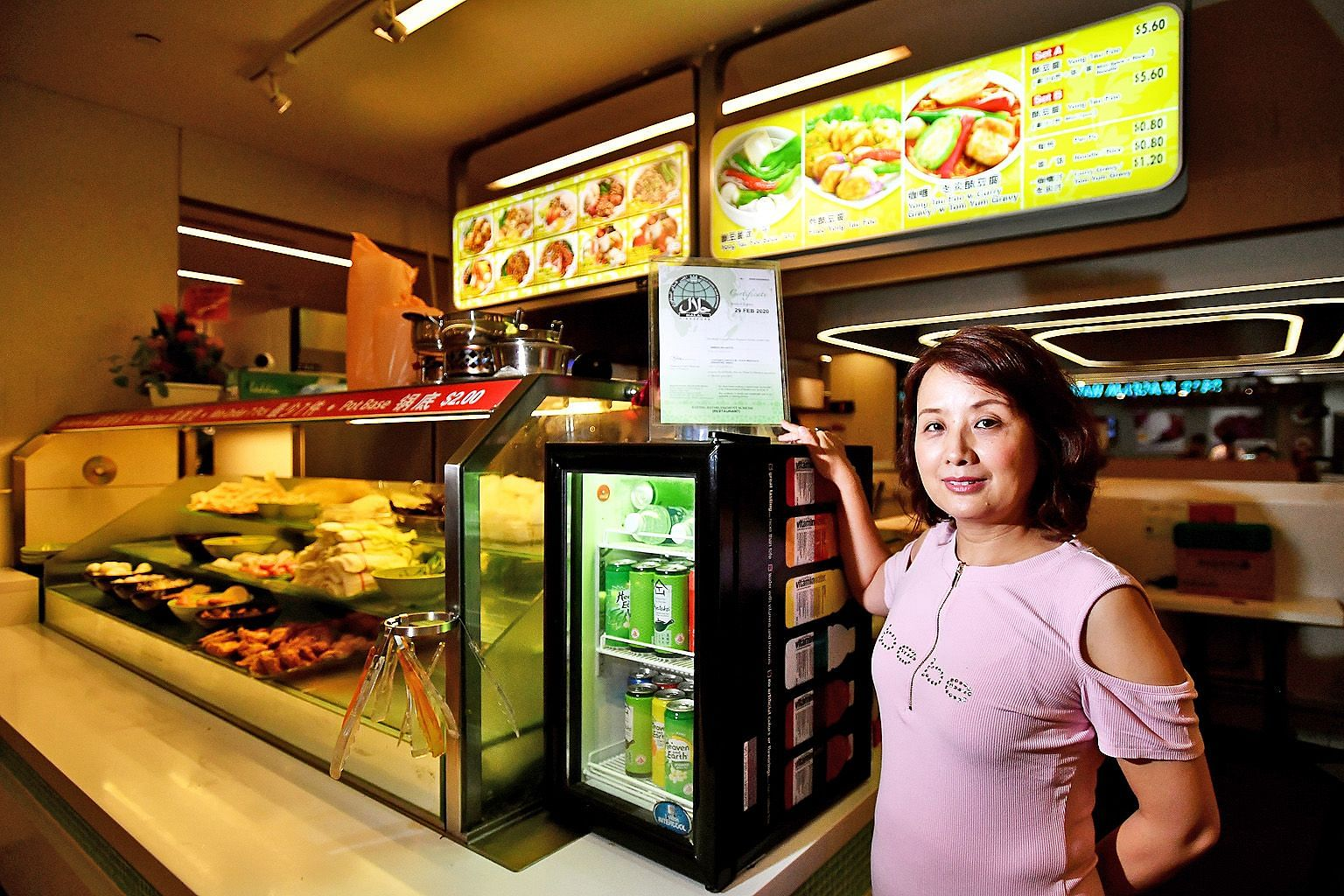 Ms May Liu, owner of halal-certified yong tau foo stall Green Delights at Westgate mall. False online claims last year led to a fall in sales, although a probe by Muis found the stall followed proper food-handling procedures.
