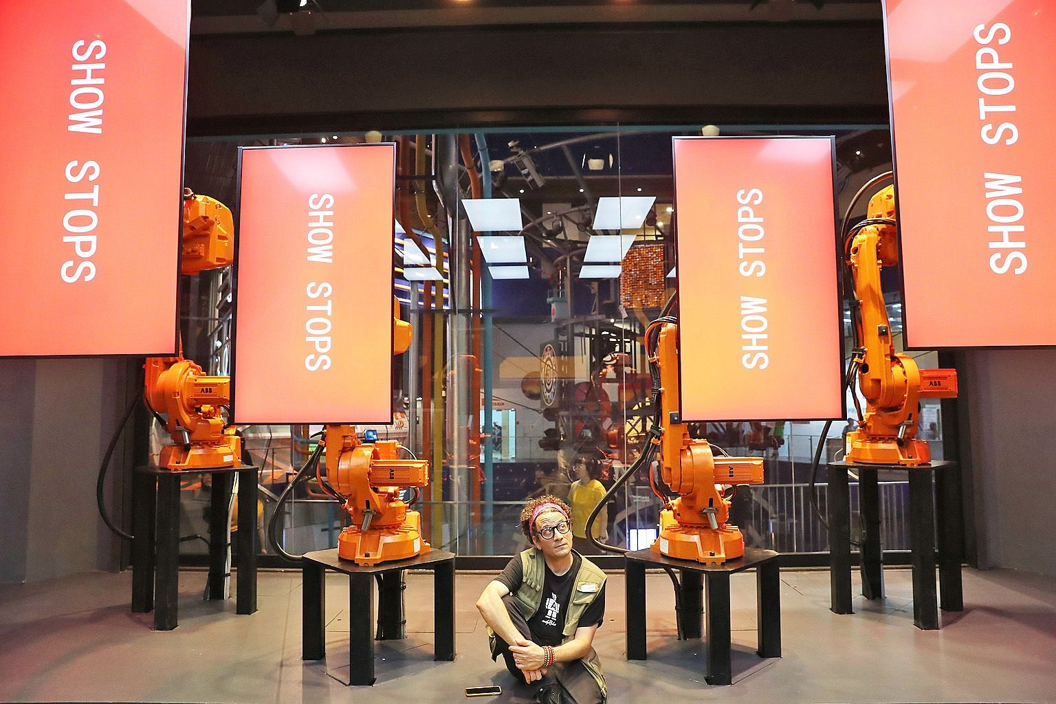 Mr Andy Flessas with his RoboScreens at the Science Centre Singapore. With the help of flexible and fluid robotic arms that can glide, bow and spin, the moving screens put on a show that explains the evolution of engineering. The robot show is part o