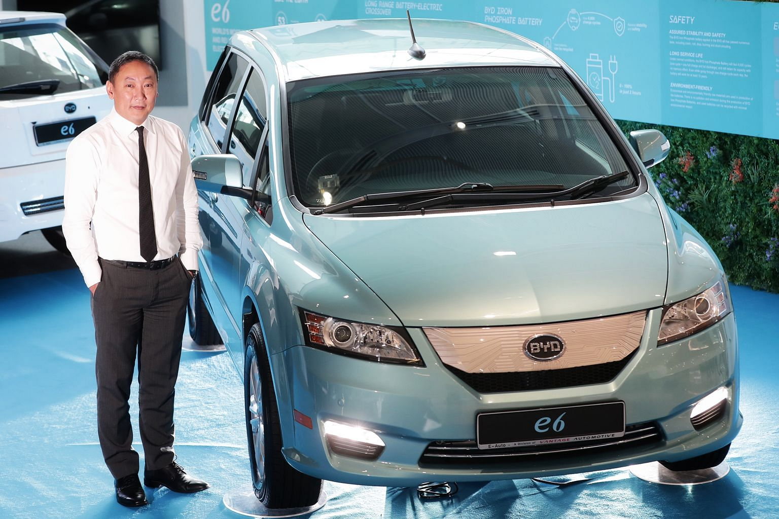 Vantage Automotive's managing director Christopher Chin, with the five-seater BYD E6, which will be priced at around $130,000, making it the least expensive electric car of its size here.