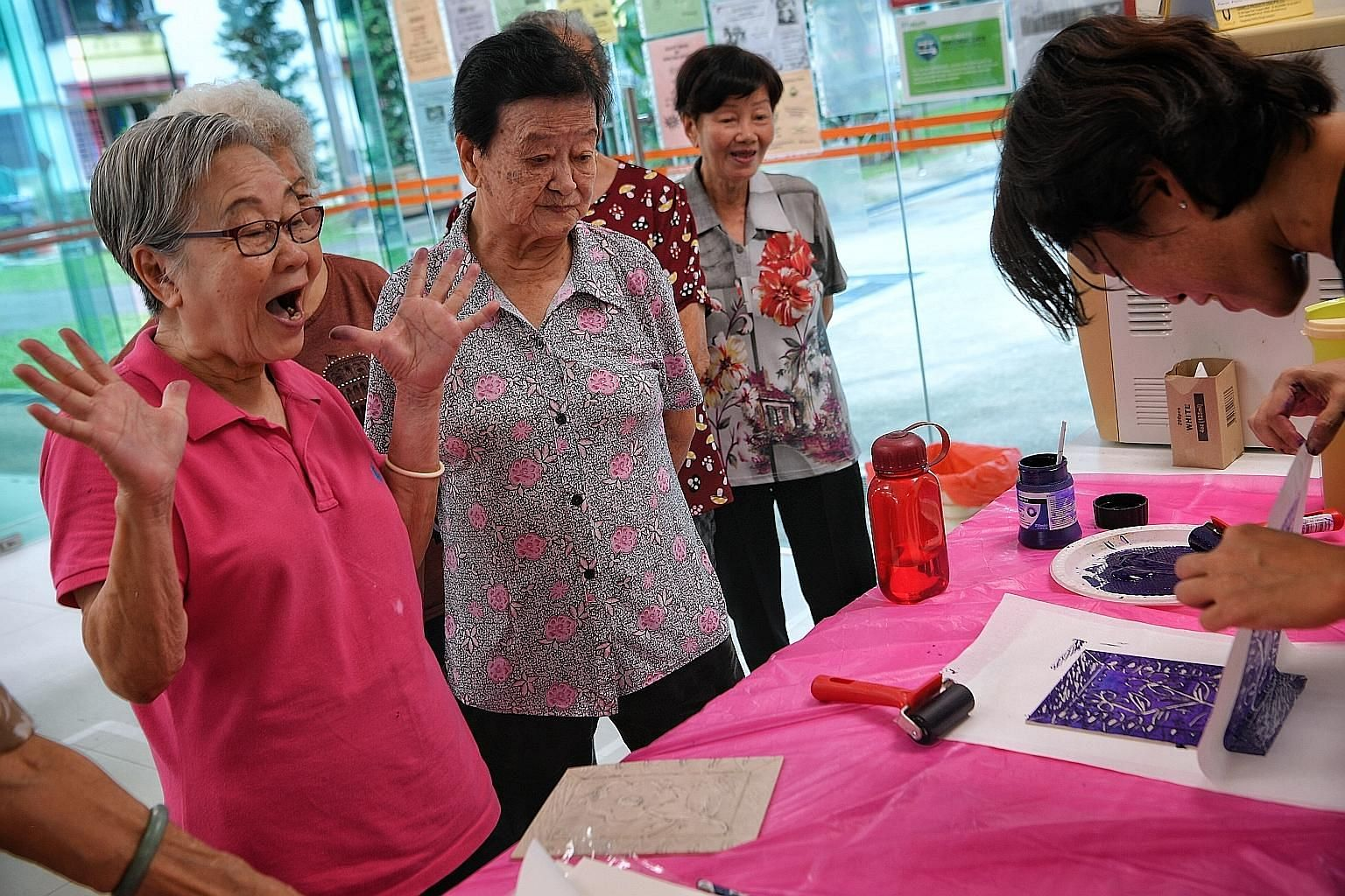 Senior citizens learning linocut as part of their printmaking lesson with artist Felicia Low at NTUC Health SilverACE (Taman Jurong) earlier this month.