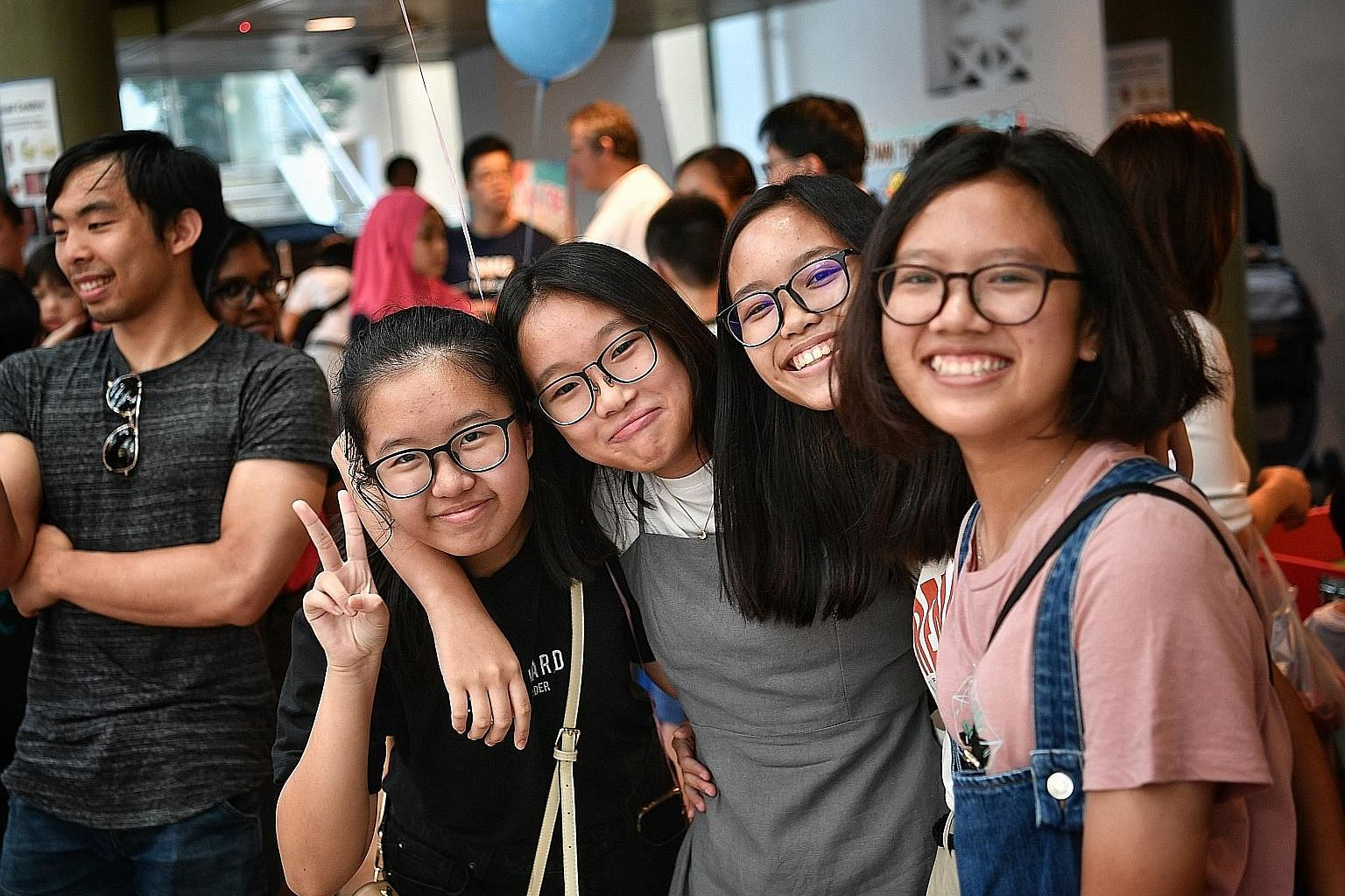 Cast member Nichelle Seow (in grey) with her friends at yesterday's launch of the film, My Face. Born with a cleft lip, she had corrective surgery when she was about four to five months old. She said she gets teased and called names, but has learnt t