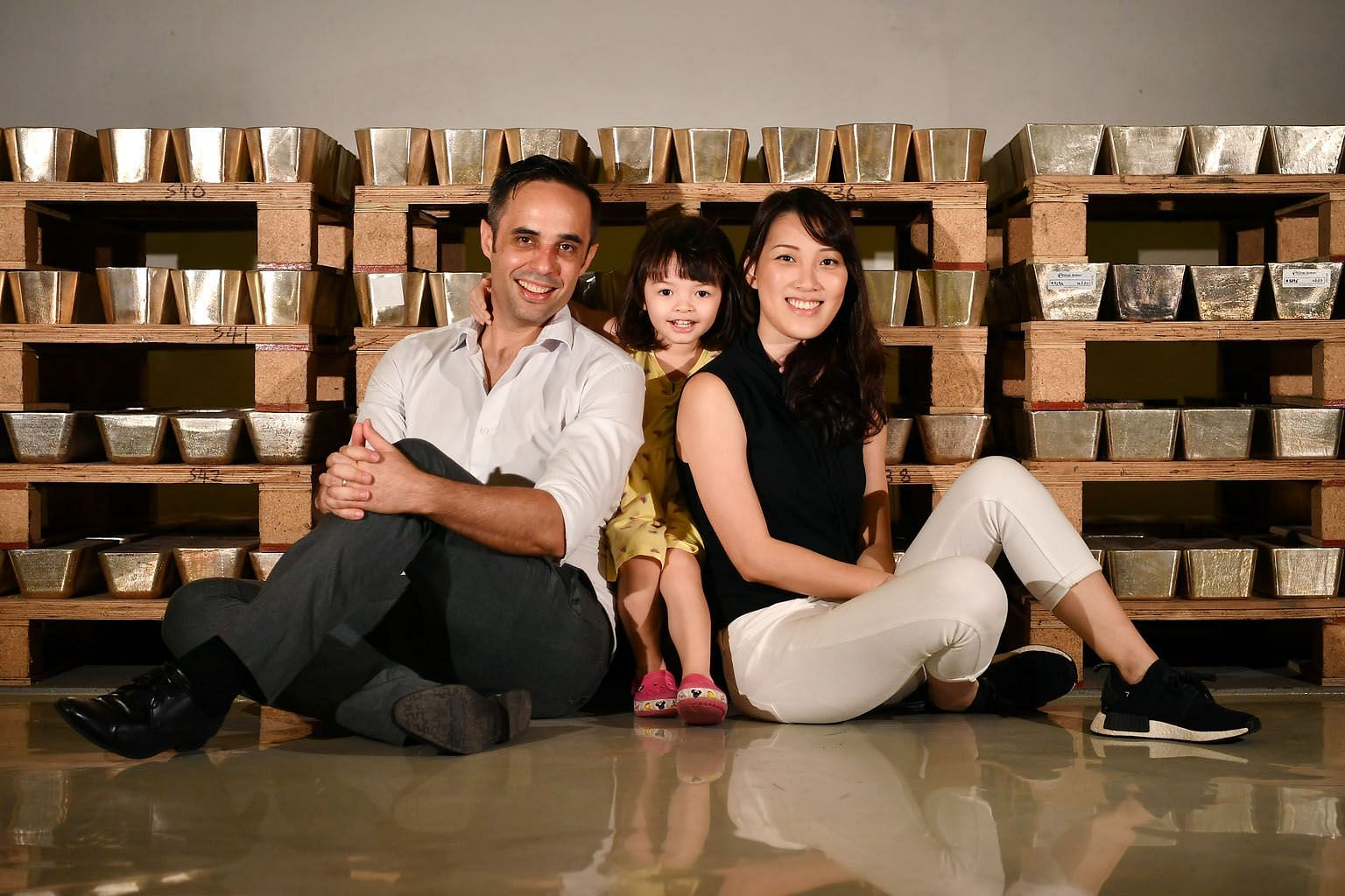 Silver Bullion founder Gregor Gregersen, with his wife Michelle Tay and daughter Daenerys, in front of silver bars at The Safe House, a precious metals vault in Chai Chee. He advocates long-term investing in undervalued assets that have good upside based