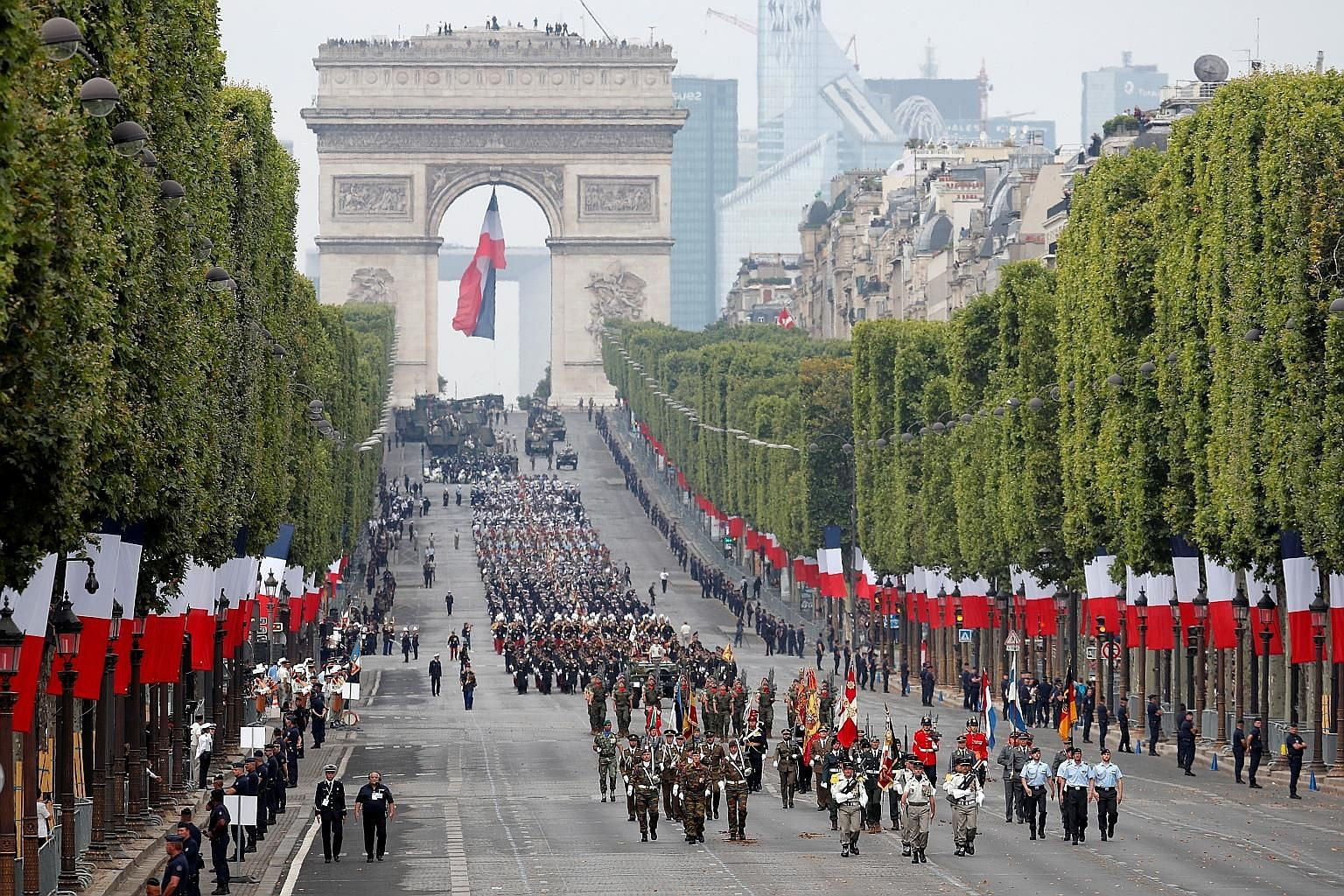 European troops marching down Champs-Elysees Avenue during the traditional Bastille Day military parade in Paris yesterday.
