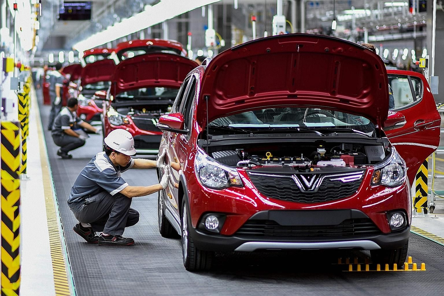 Workers at the assembly line of the new plant of VinFast, Vietnam's first home-grown car manufacturer. Analysts have singled out Vietnam as a clear winner of US tariffs on China. US imports of dutiable products from the country surged 29 per cent in