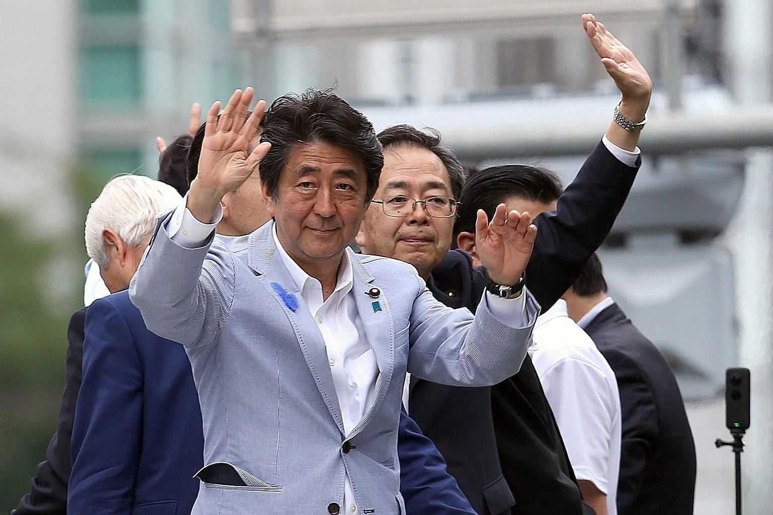 Japanese Prime Minister Shinzo Abe, who is the Liberal Democratic Party (LDP) president, at a campaign rally in Kobe yesterday. A recent poll showed support for the LDP rising to 31 per cent from two weeks ago. PHOTO: BLOOMBERG