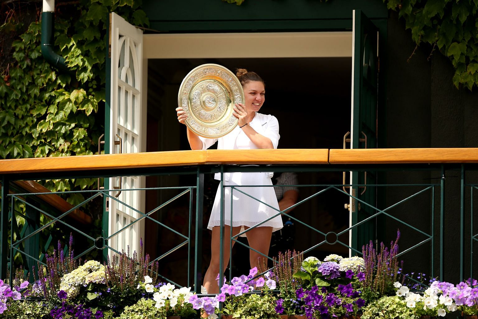 """Romanian tennis star Simona Halep with the Venus Rosewater Dish after beating fellow former world No. 1 Serena Williams in Saturday's Wimbledon women's singles final, which she described as """"the best match of my life""""."""