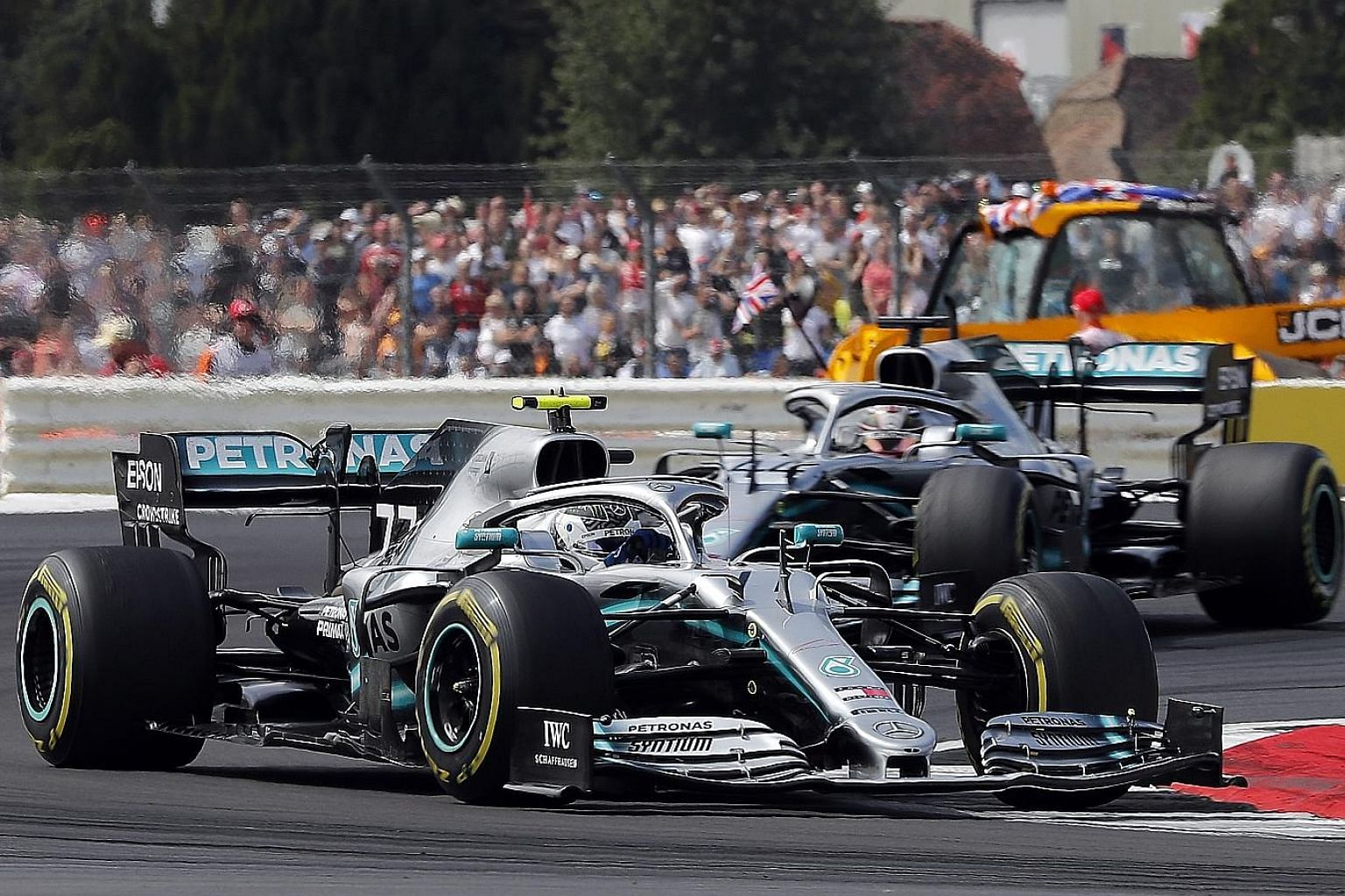 Valtteri Bottas (front) leading Mercedes teammate Lewis Hamilton in an early stage of the British Grand Prix at the Silverstone circuit. The design of the track gave drivers space to overtake, which race winner Hamilton did, albeit via a pit-lane mis