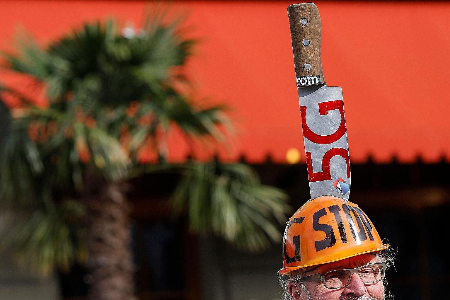 A demonstrator wearing a helmet with a knife during a protest against the 5G mobile communications network in Bern, Switzerland, in May.