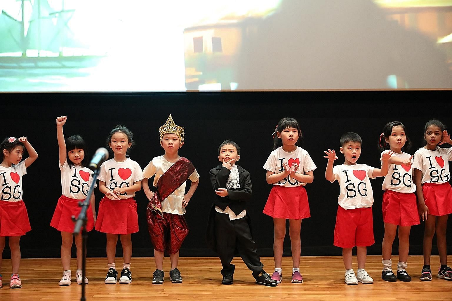 Children from PCF Sparkletots performing a skit at the National Museum of Singapore's Gallery Theatre yesterday about Singapore's past, present and future. The skit was among the performances that kicked off this year's Joy of Reading programme.