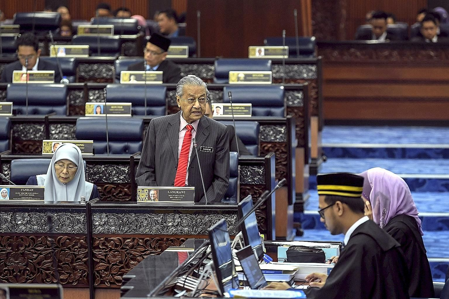 Malaysian Prime Minister Mahathir Mohamad during a question-and-answer session in Parliament yesterday. Lowering the voting age to 18 was one of Pakatan Harapan's key pledges in the run-up to last year's general election. The move will bring Malaysia