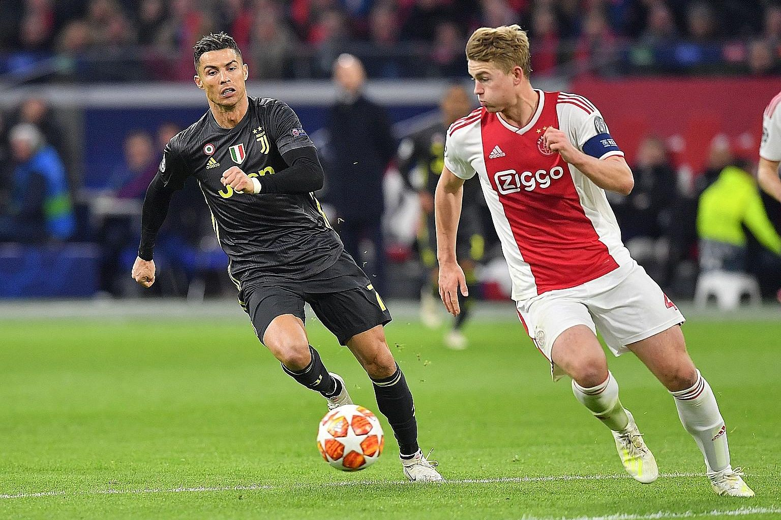 Juventus' Cristiano Ronaldo, seen chasing Ajax's Matthijs de Ligt during their Champions League quarter-final tie in April, can look forward to lining up alongside the Dutch defender in Italy next season. De Ligt is poised to sign for the Italian cha