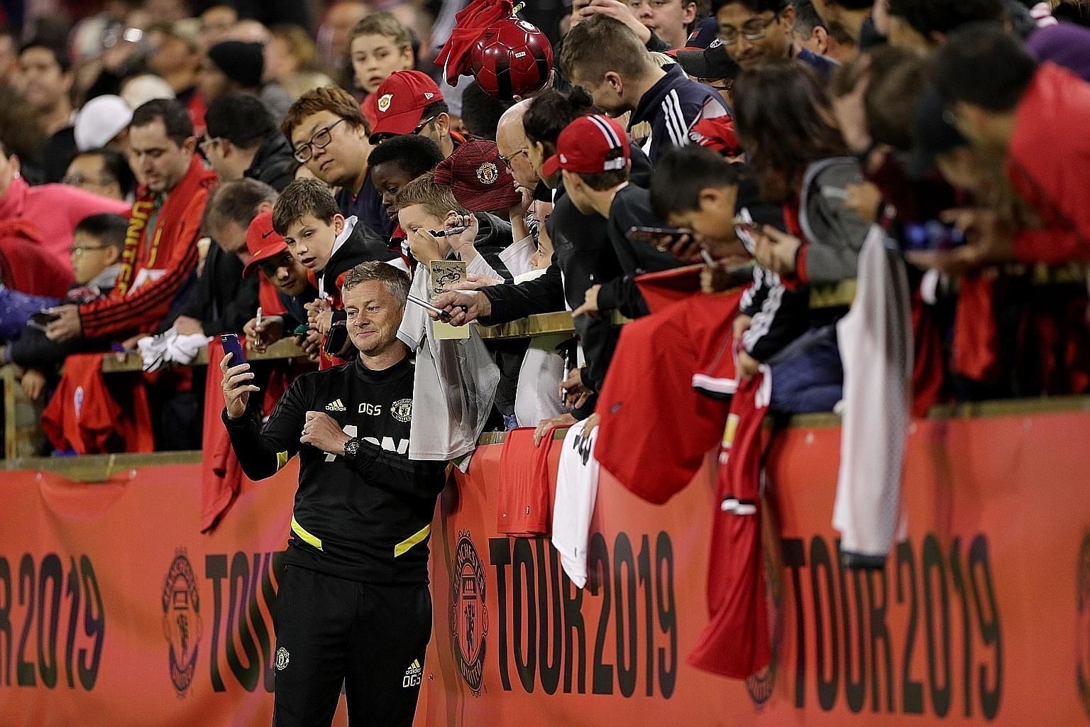 Manchester United manager Ole Gunnar Solskjaer obliging fans with a photo after training at the Perth Stadium. The English Premier League club is touring Australia and will play Leeds United today before heading to Singapore.