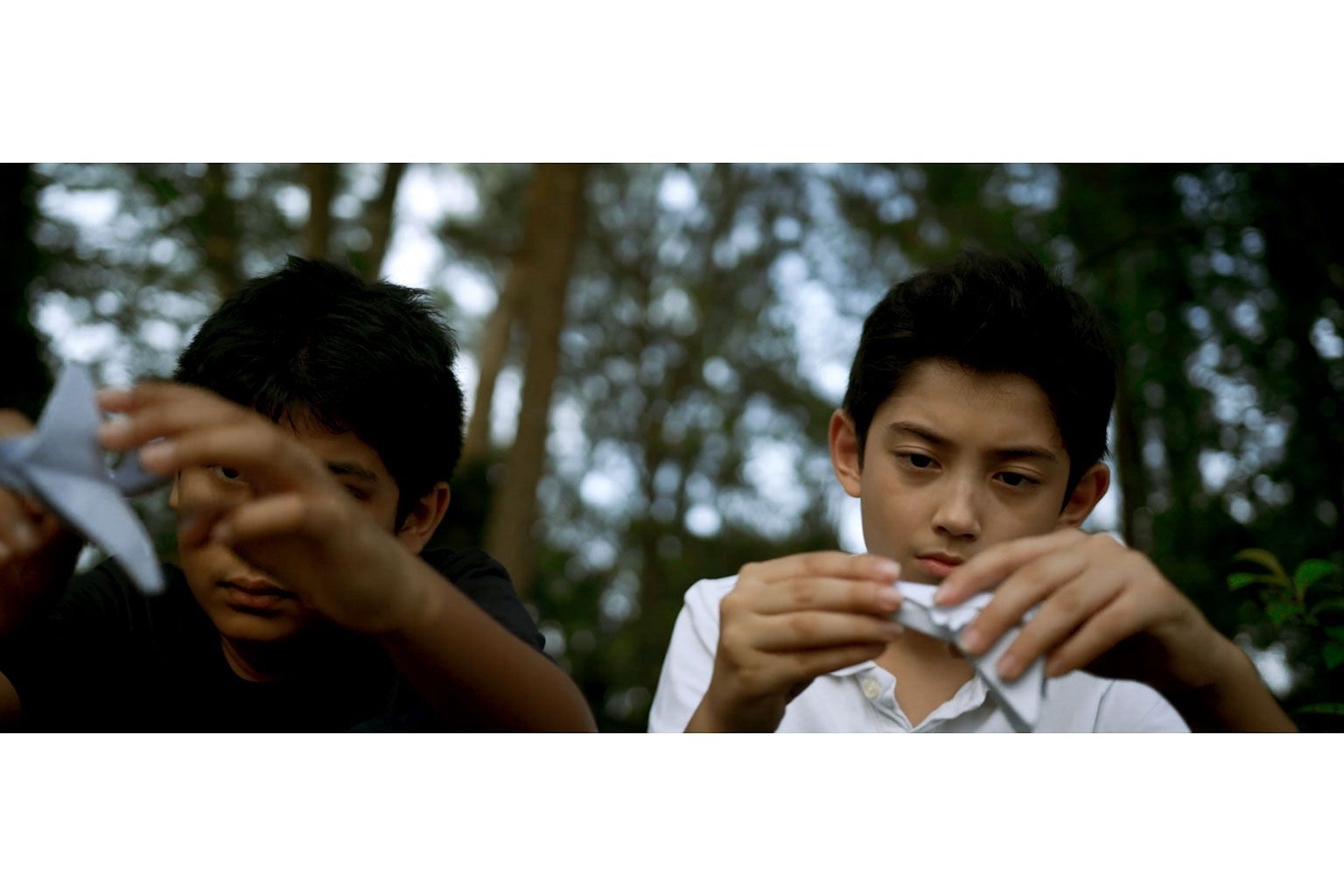 Dharshan Nathan (far left) and Kaiden Quinn (left) in a still from We Will Burn, a short film by Amanda Tan, based on Ng Yi-Sheng's poem The Audience. It will be one of eight short films screened at the Poetry Festival Singapore.
