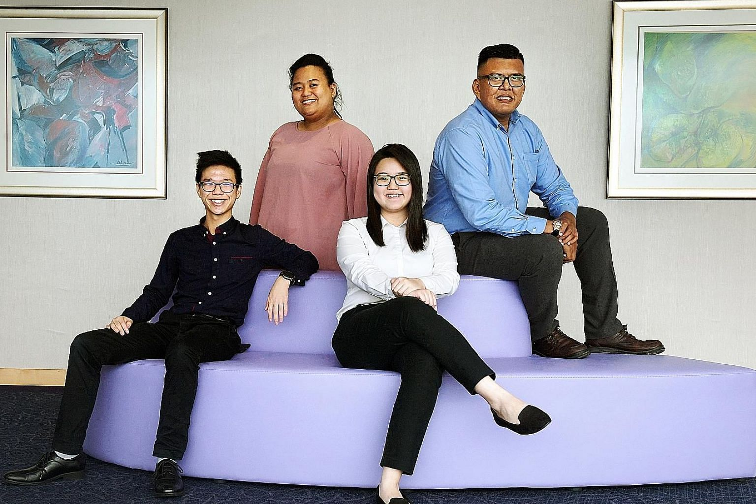 ITE graduates who received awards included (from left) Mr Nathaniel Neo, 19, winner of the IES Engineering Award; Ms Siti Nurhajah Haron, 24, and Ms Nicole Goh, 18, who were both given the Lee Kuan Yew Gold Medal; and Mr Muhammad Khairul Johari Jumah