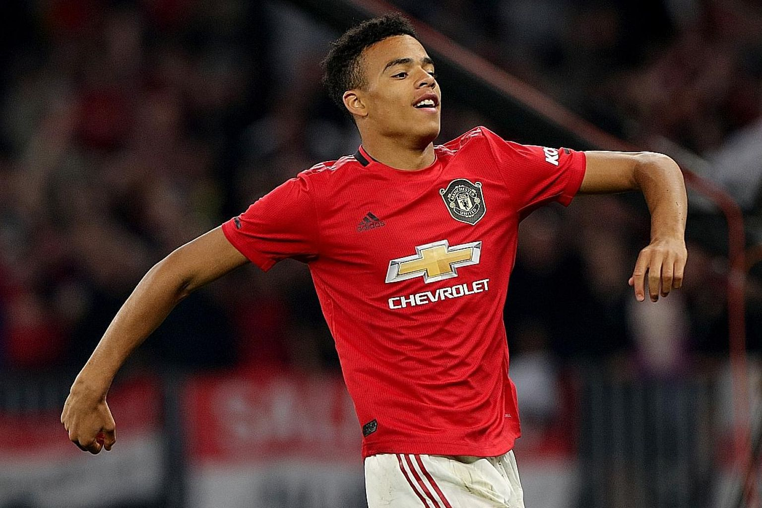Mason Greenwood celebrating after netting the opener against Leeds. The 17-year-old striker will have a role to play off the bench next term. PHOTO: DPA