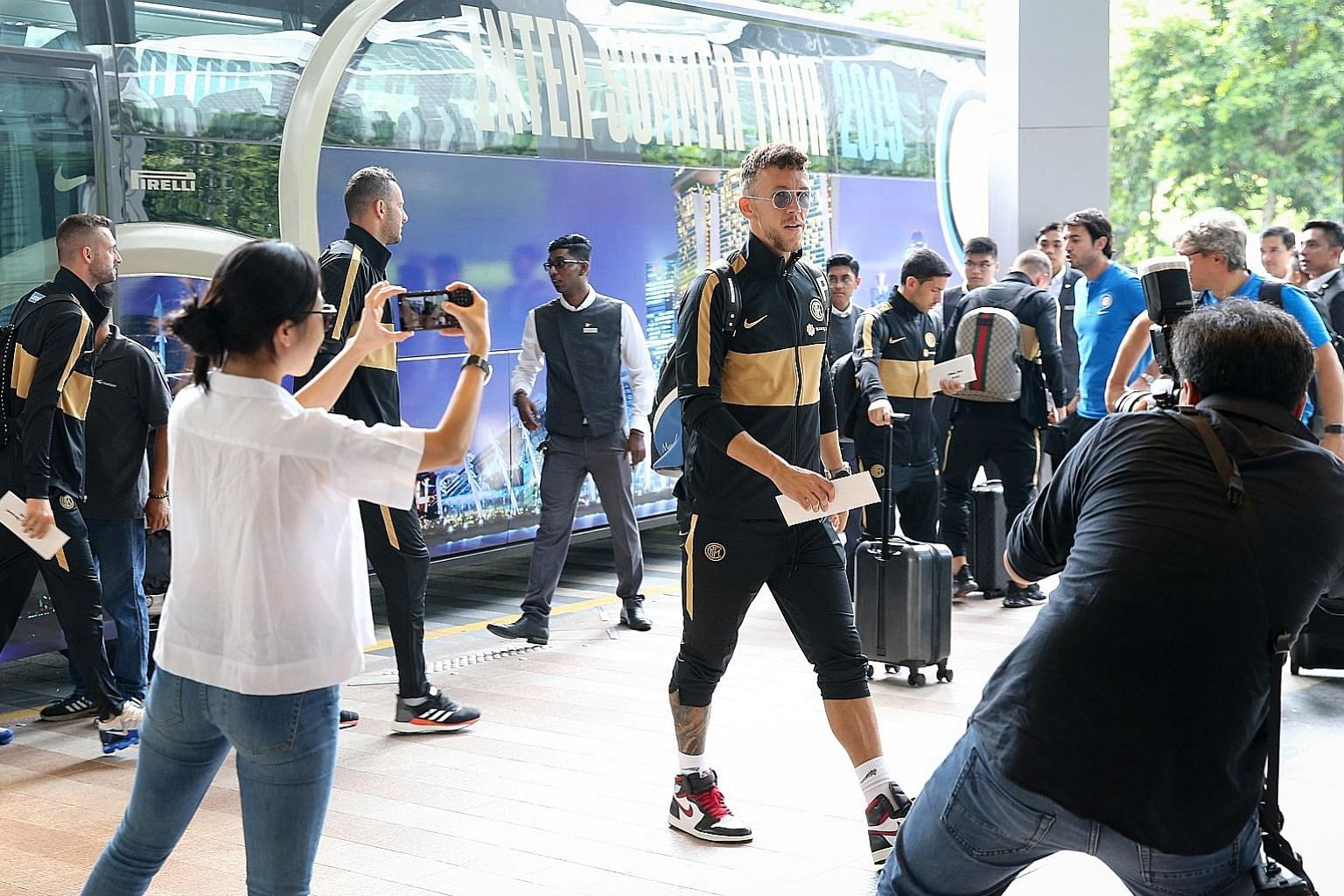 Left: Inter Milan's Ivan Perisic arriving at the hotel yesterday with his teammates. The Italian club will be playing against Manchester United on Saturday, while Juventus will meet Tottenham on Sunday in the International Champions Cup at the Nation