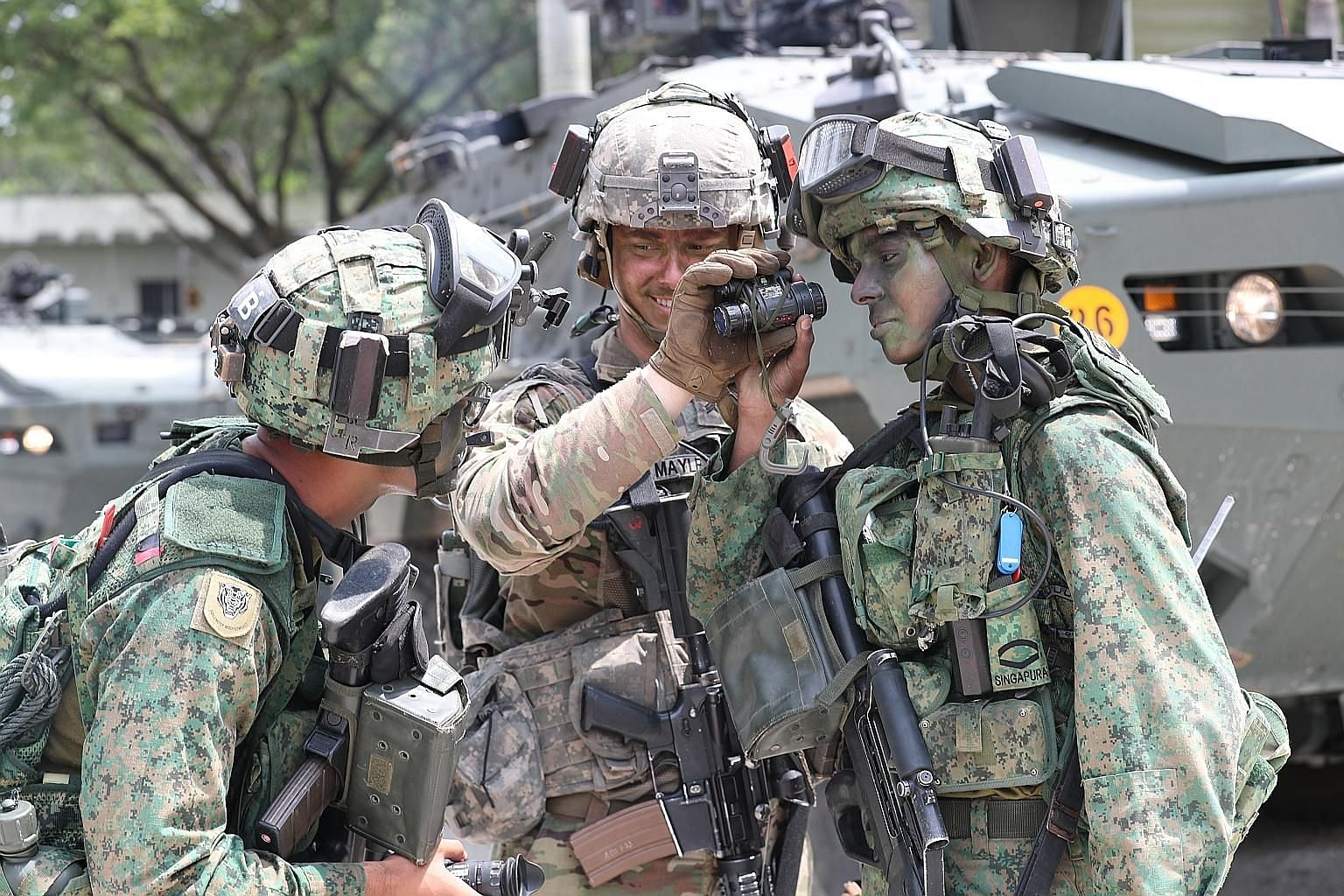 From far left: Singapore Armed Forces (SAF) Third Sergeant Harith Afiq Azman, 23; United States Army Sergeant David T. Mayle, 24; and SAF Lance Corporal Mo Thana Viknesh Waran, 21, at the Murai Urban Training Facility yesterday for Exercise Tiger Bal