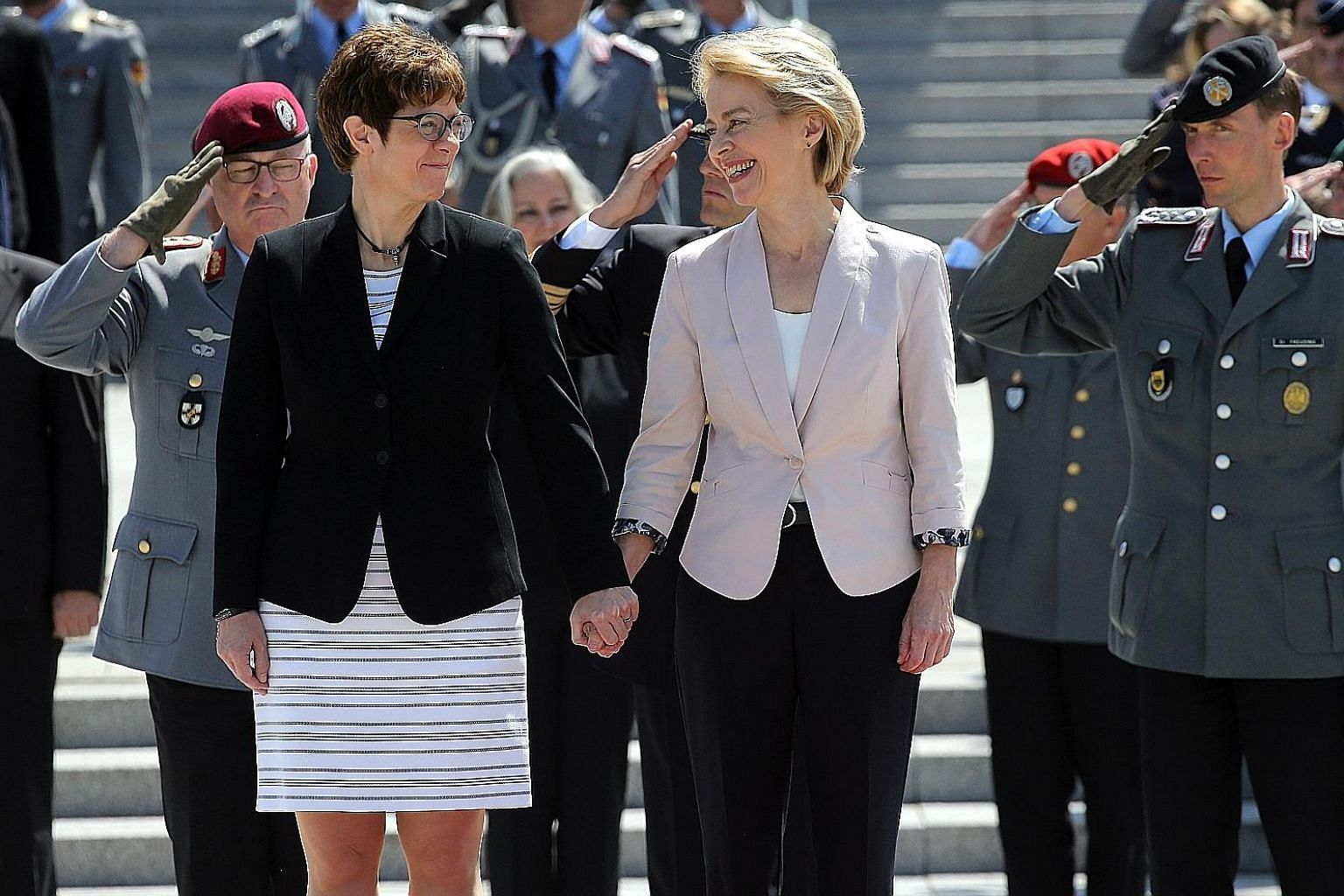 Dr Ursula von der Leyen (right), outgoing German defence minister and newly elected president of the European Commission, with Ms Annegret Kramp-Karrenbauer, the chairman of the Christian Democratic Union who takes over the defence post, during an in