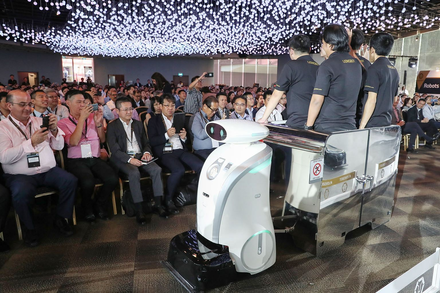 LeoPull, a robot that can transport up to 450kg of cleaning equipment, on show at the launch event yesterday. Local firm LionsBot International has developed 13 different robot models that can scrub, mop, vacuum, sweep, shine and even transport clean
