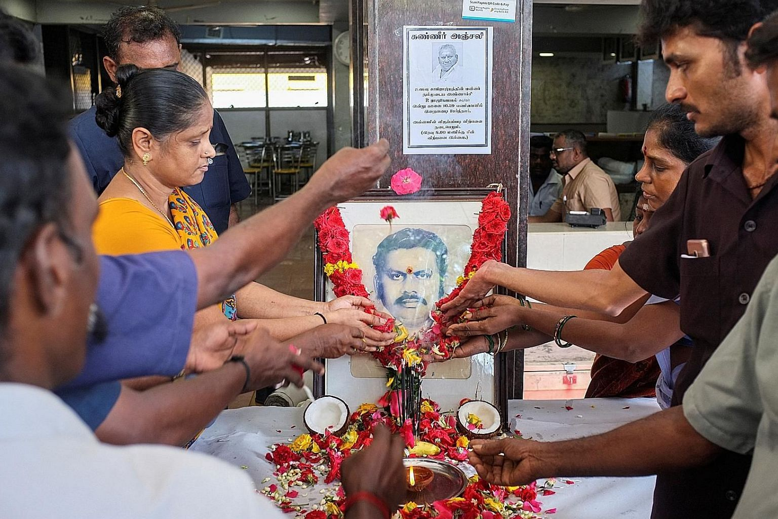 Employees paying tribute to Indian restaurant tycoon P. Rajagopal in Chennai yesterday.