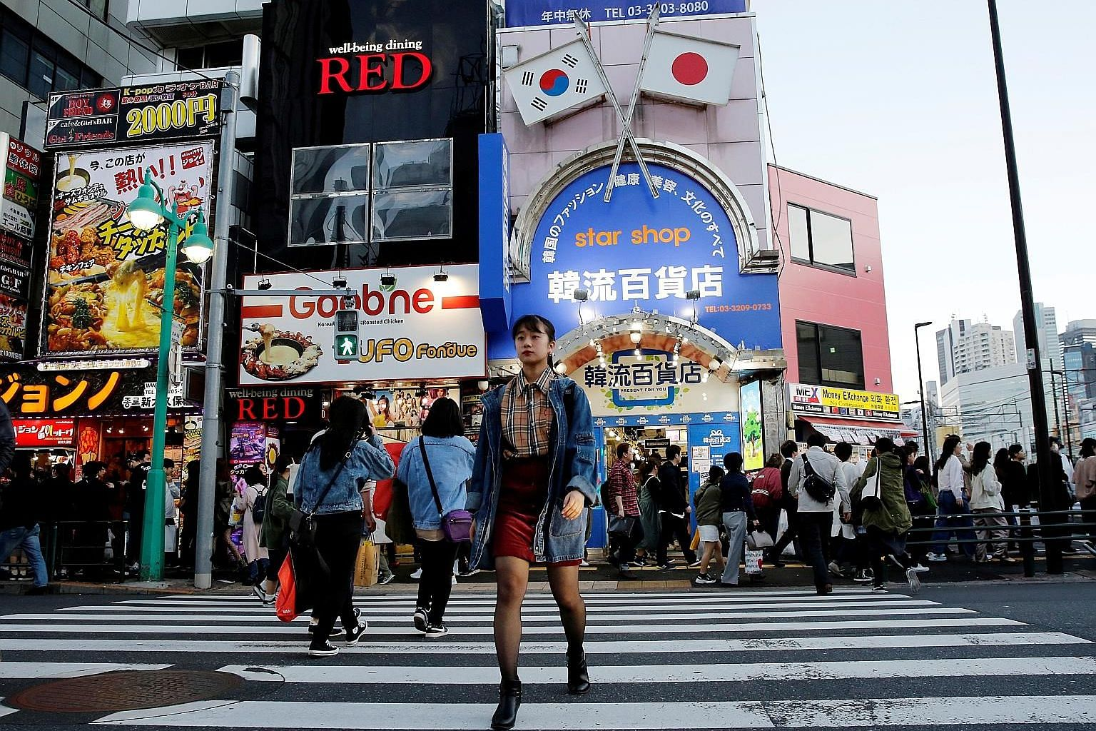 "Korean businesses in Tokyo's Shin-Okubo district, which is known as ""Korea town"", have reported barely a dent in takings since the latest dispute erupted, as South Korean culture remains wildly popular among the Japanese."