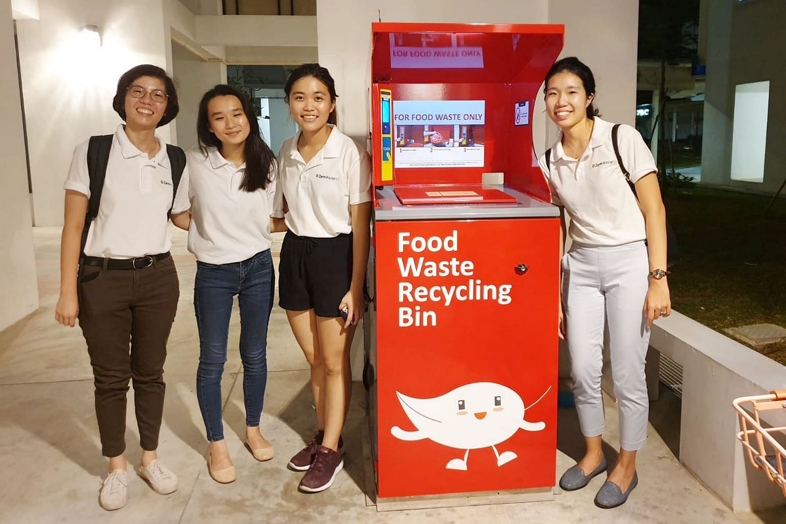 Ms Pek Hai Lin (far right) with staff from Zero Waste SG during an outreach effort earlier this year as part of a food-waste recycling pilot at Tampines Greenlace estate. She received the EcoFriend Award yesterday from Minister for the Environment an