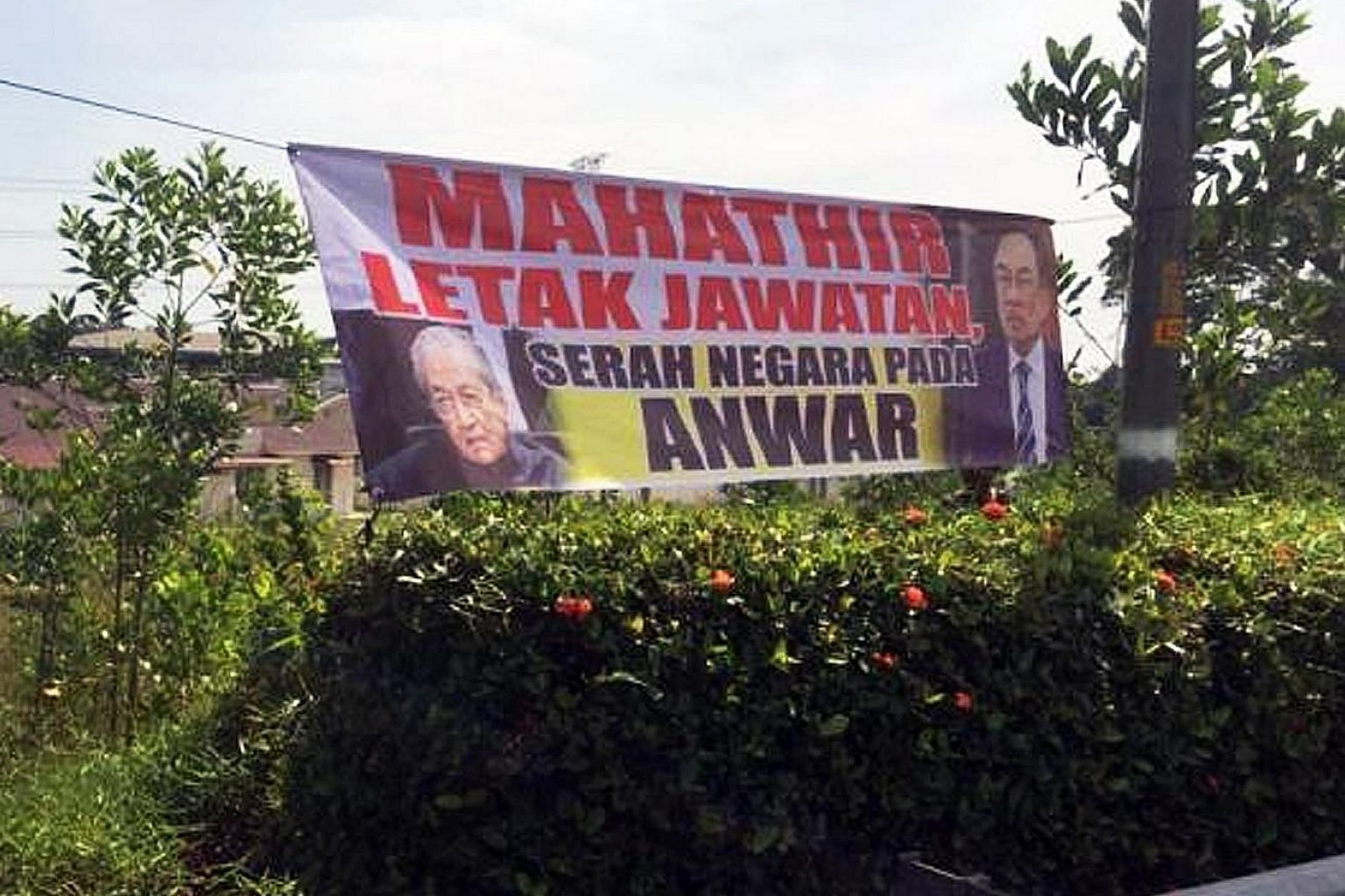 """One of the banners in Port Dickson with a message in Malay reading """"Mahathir step down, leave the country to Anwar"""". The banners were put up ahead of of a PKR retreat attended by Prime Minister Mahathir Mohamad."""