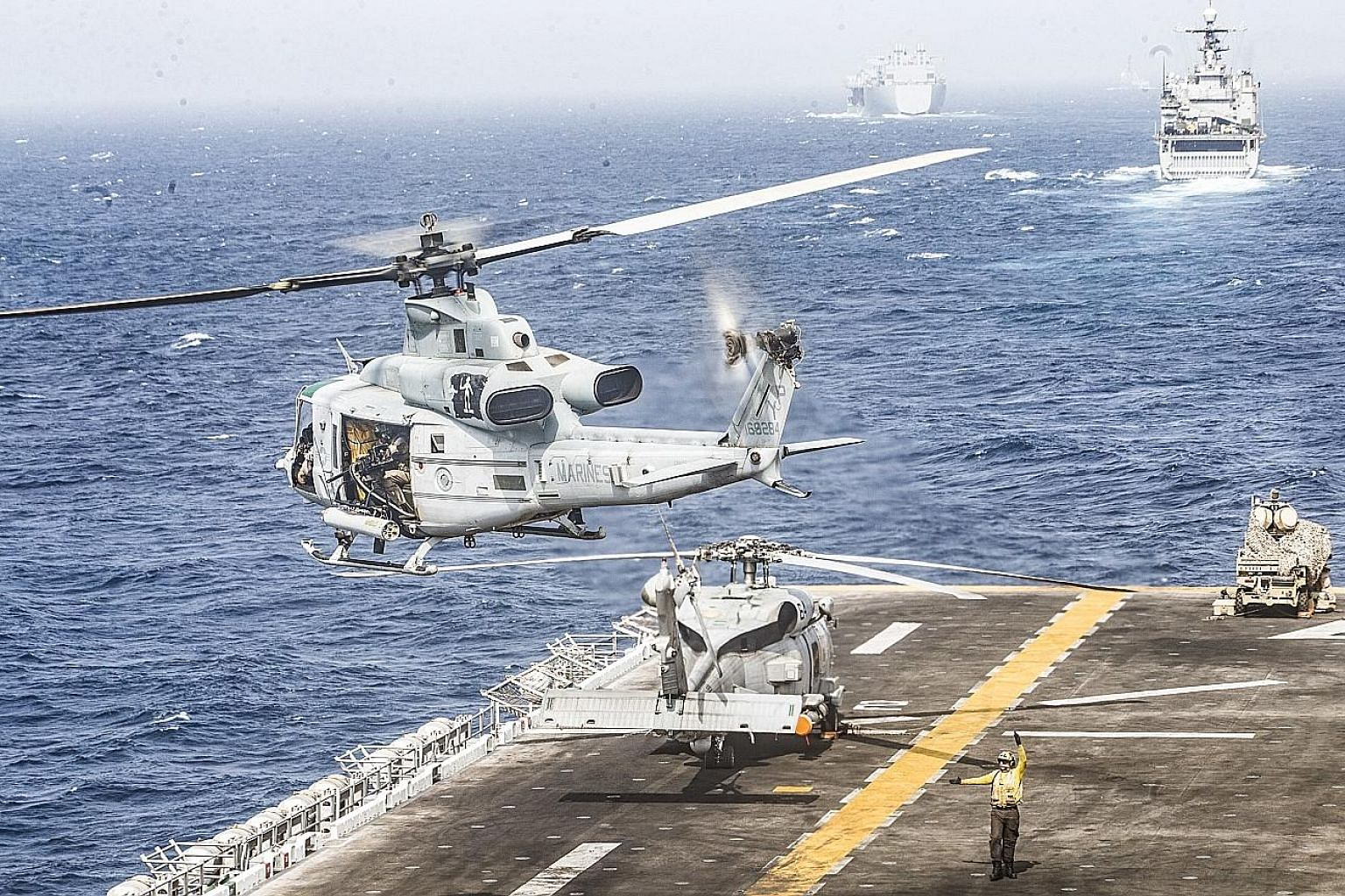 A helicopter taking off from the Boxer, a US amphibious assault ship, in the Strait of Hormuz, on Thursday. President Donald Trump said on Thursday the US Navy had shot down an Iranian drone that threatened the Boxer. PHOTO: NYTIMES