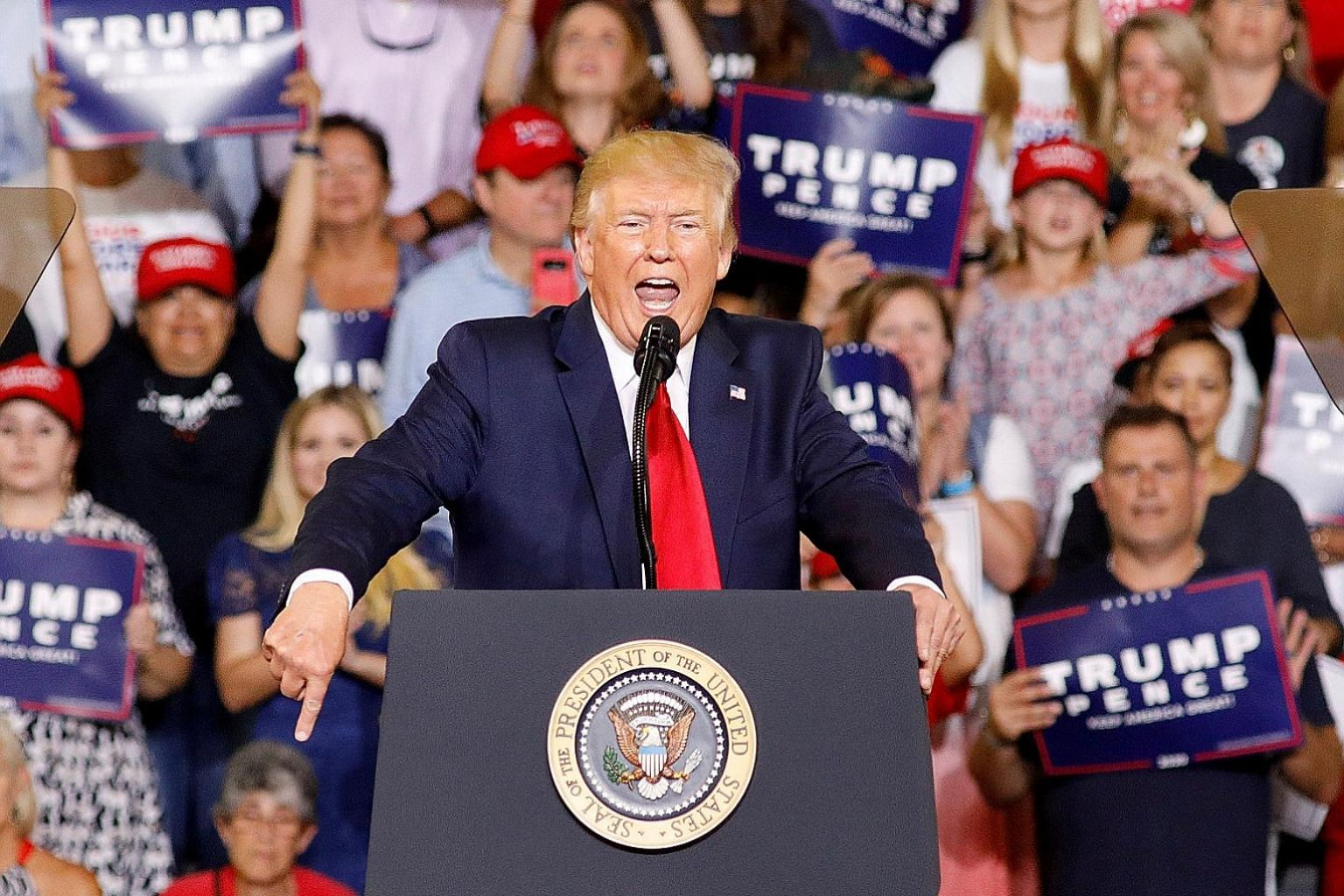 "US President Donald Trump speaking at a rally in Greenville, North Carolina, on Wednesday. Nervous Republicans have urged Mr Trump to repudiate a ""send her back"" rally chant directed at congresswoman Ilhan Omar. PHOTO: REUTERS"