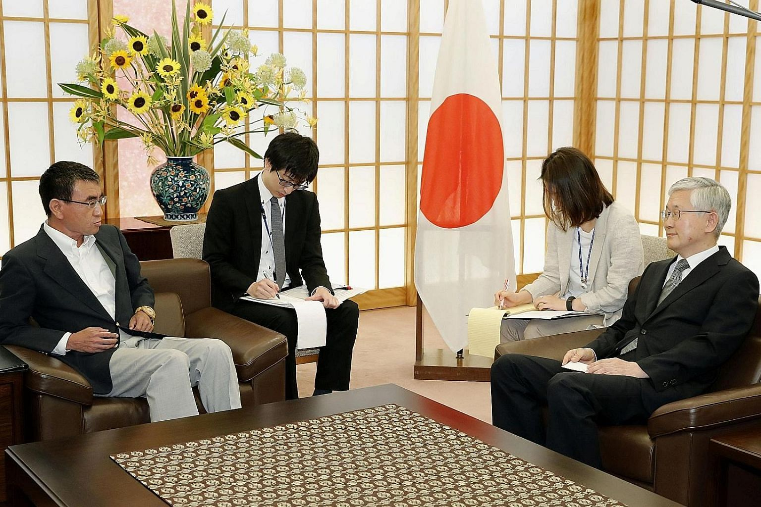 "Japanese Foreign Minister Taro Kono (far left) told South Korea's Ambassador Nam Gwan-pyo at the Foreign Ministry in Tokyo yesterday that what Seoul is doing ""is equal to subverting the international order built after World War II"". PHOTO: REUTERS"