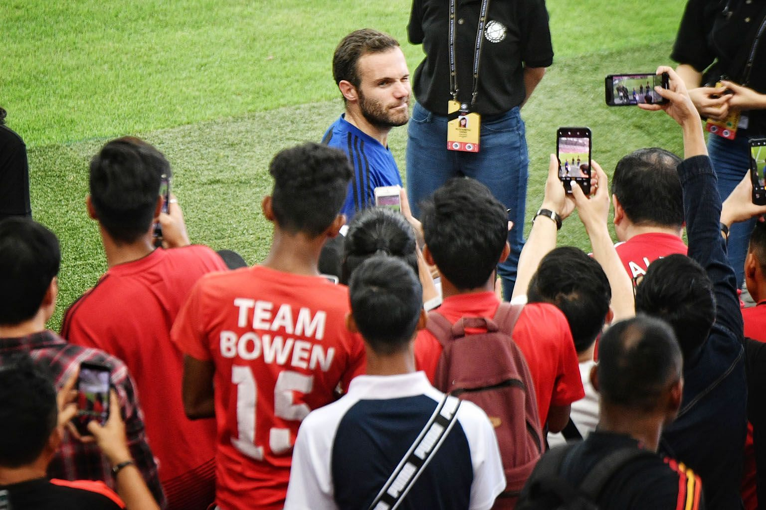 Veteran midfielder Juan Mata taking time to engage the fans after Manchester United's training session at National Stadium yesterday, ahead of their ICC match against Inter Milan tonight.
