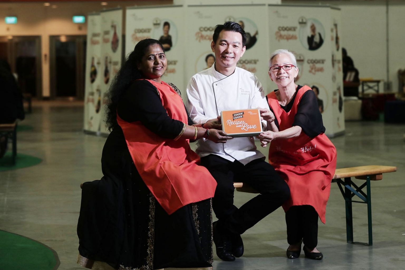Madam Sakunthla Chelladurai, Mr Bernard Lim and Madam Ng Mee Lan are among 21 chefs and cooks featured in Recipes With Love, a set of 21 recipe cards of healthy meals for children compiled by dietitians and nutritionists. ST PHOTO: KELVIN CHNG