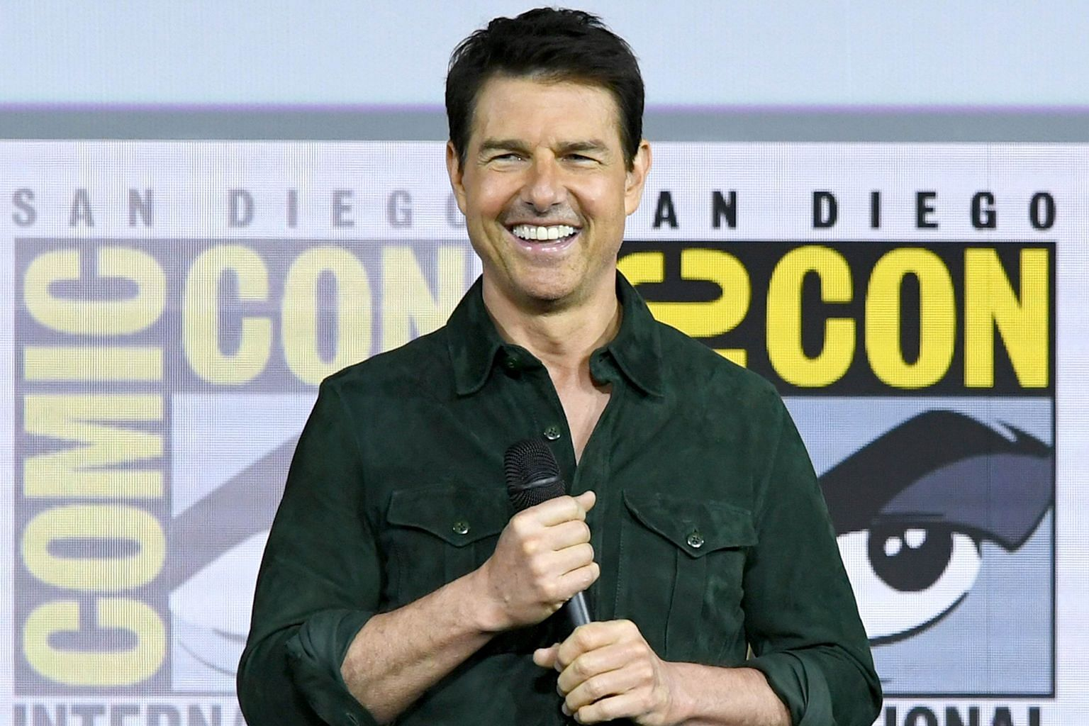 """Tom Cruise unveiling the trailer for Top Gun: Maverick at San Diego Comic-Con on Thursday, calling it a """"love letter to aviation""""."""