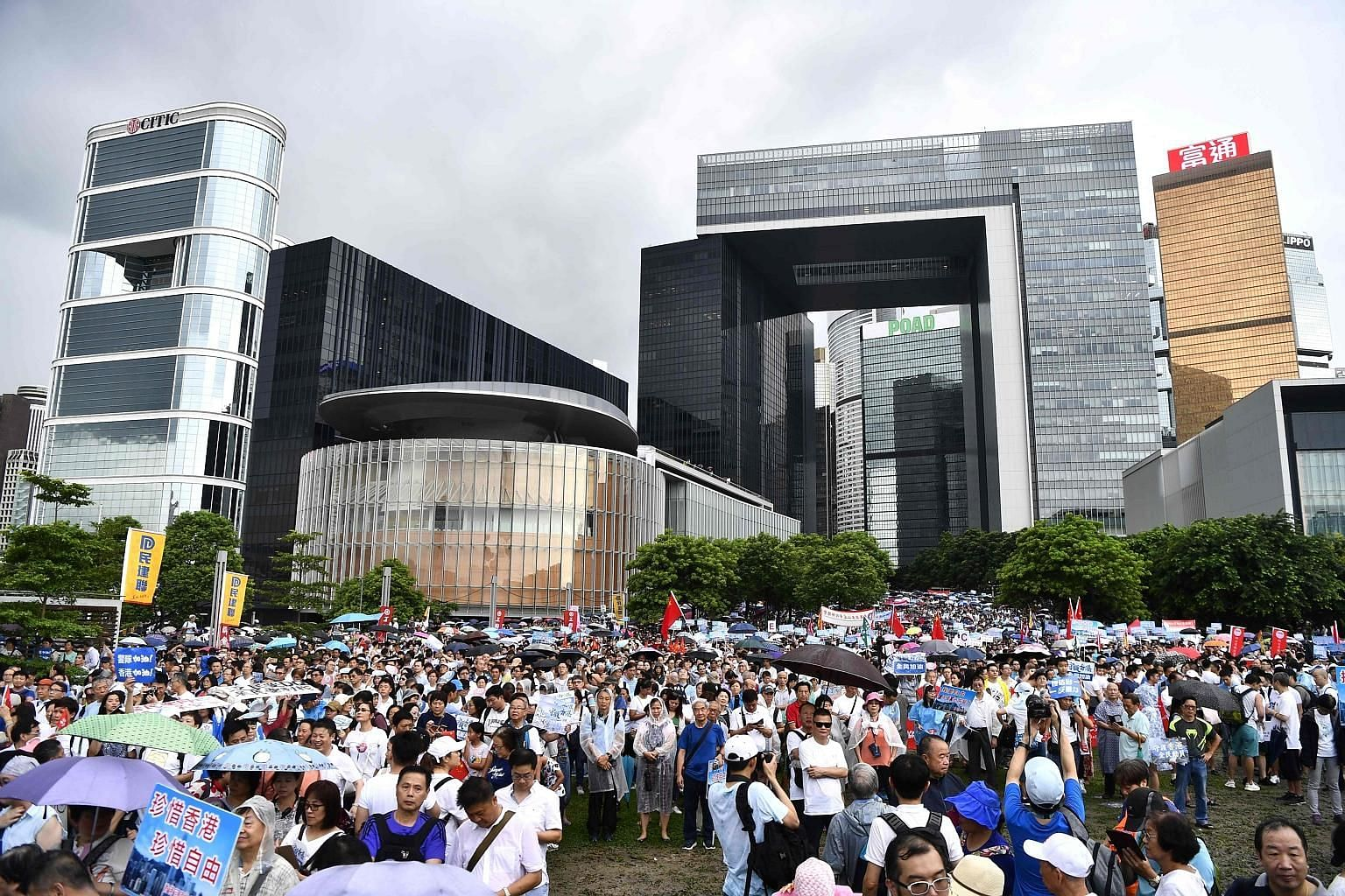 Demonstrators attending a pro-government rally outside the Hong Kong government headquarters yesterday to show support for the police and pro-Beijing leadership. In an address to be delivered in October, Chief Executive Carrie Lam plans to emphasise