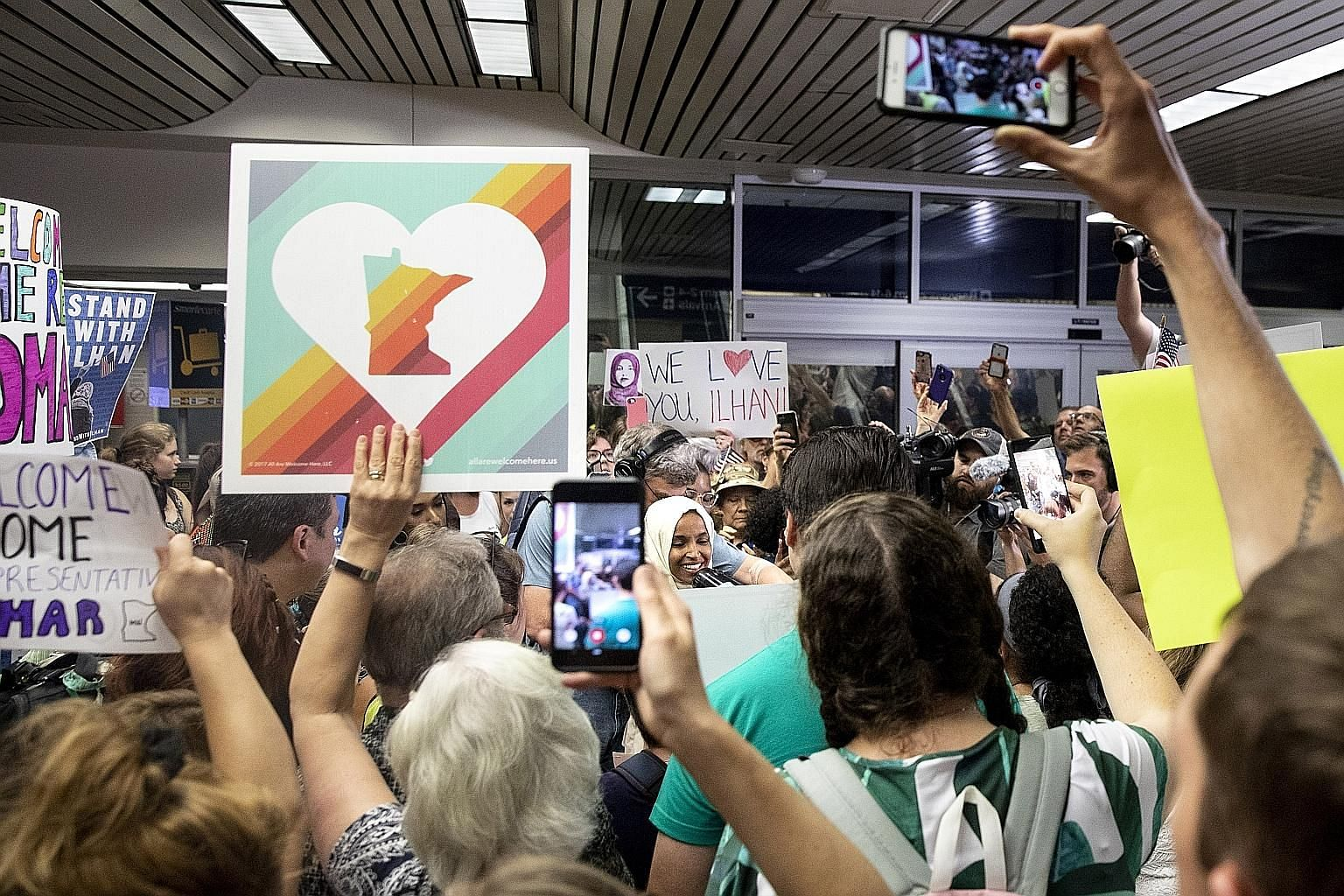"Supporters welcoming home Democratic Congresswoman Ilhan Omar at the Minneapolis-St Paul Airport last Thursday. A crowd at President Donald Trump's rally in North Carolina the day before had chanted ""Send her back"", referring to Ms Omar, who was born"