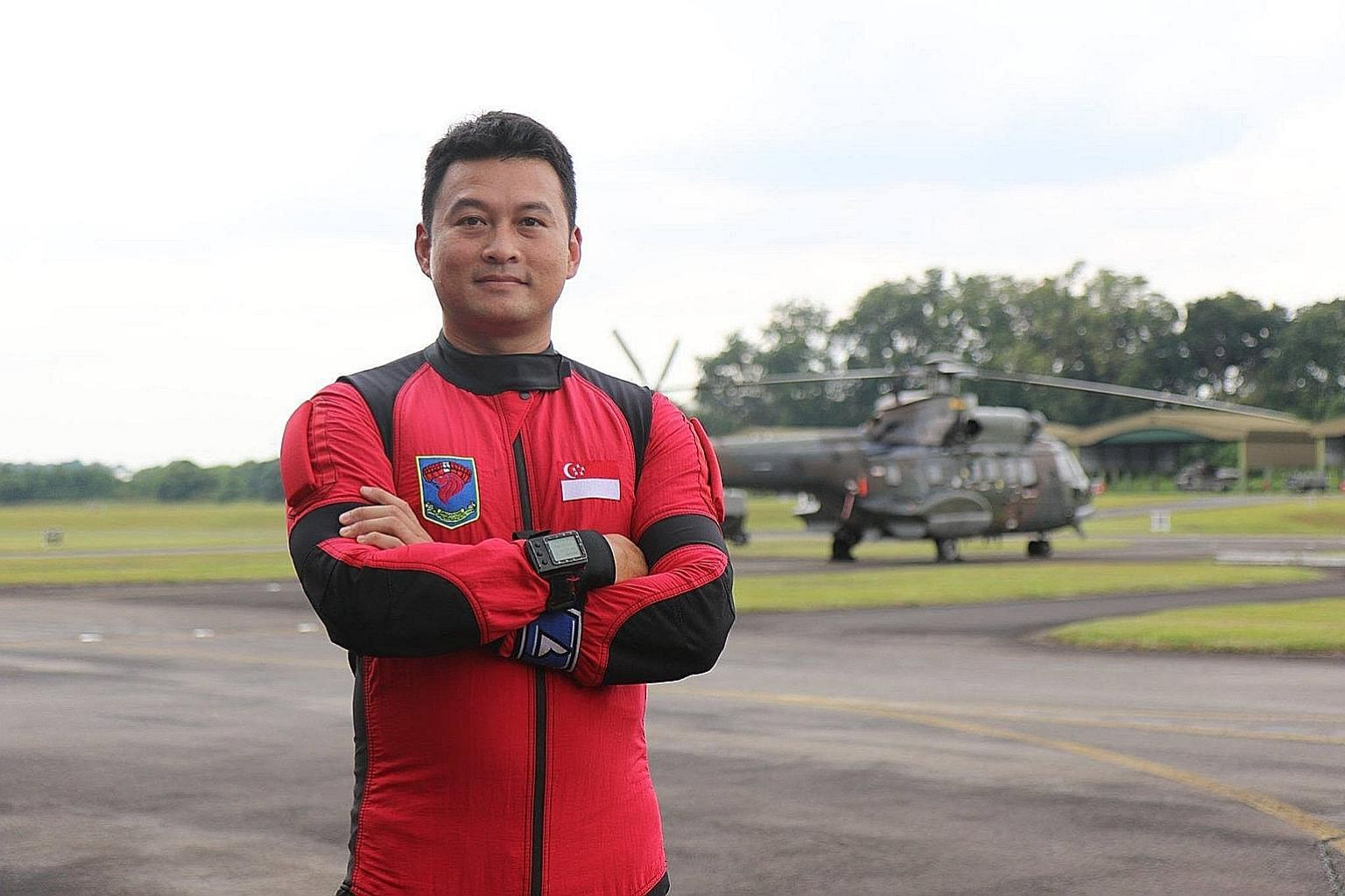 This National Day, Second Warrant Officer Russell Ong will free-fall with eight fellow Red Lions from a height of over 3,000m to land on the Padang.