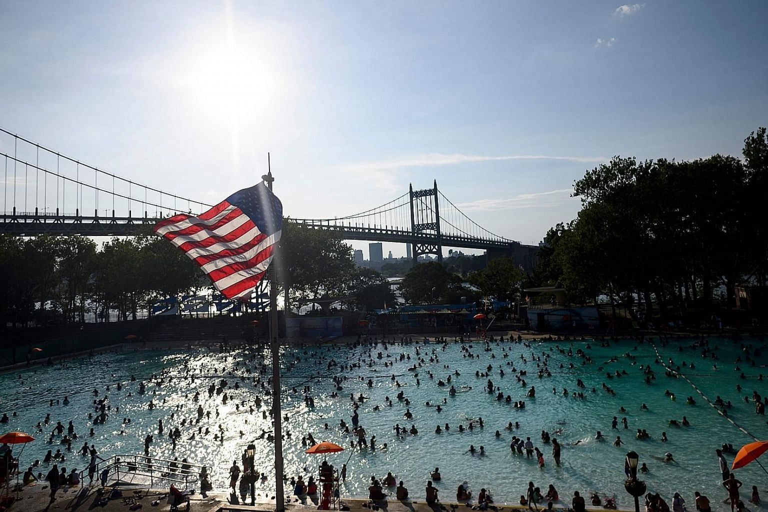 Crowds at a public swimming pool in New York City over the weekend as the US was hit by extremely hot weather, with daytime temperatures forecast to approach 38 deg C across a number of major cities.