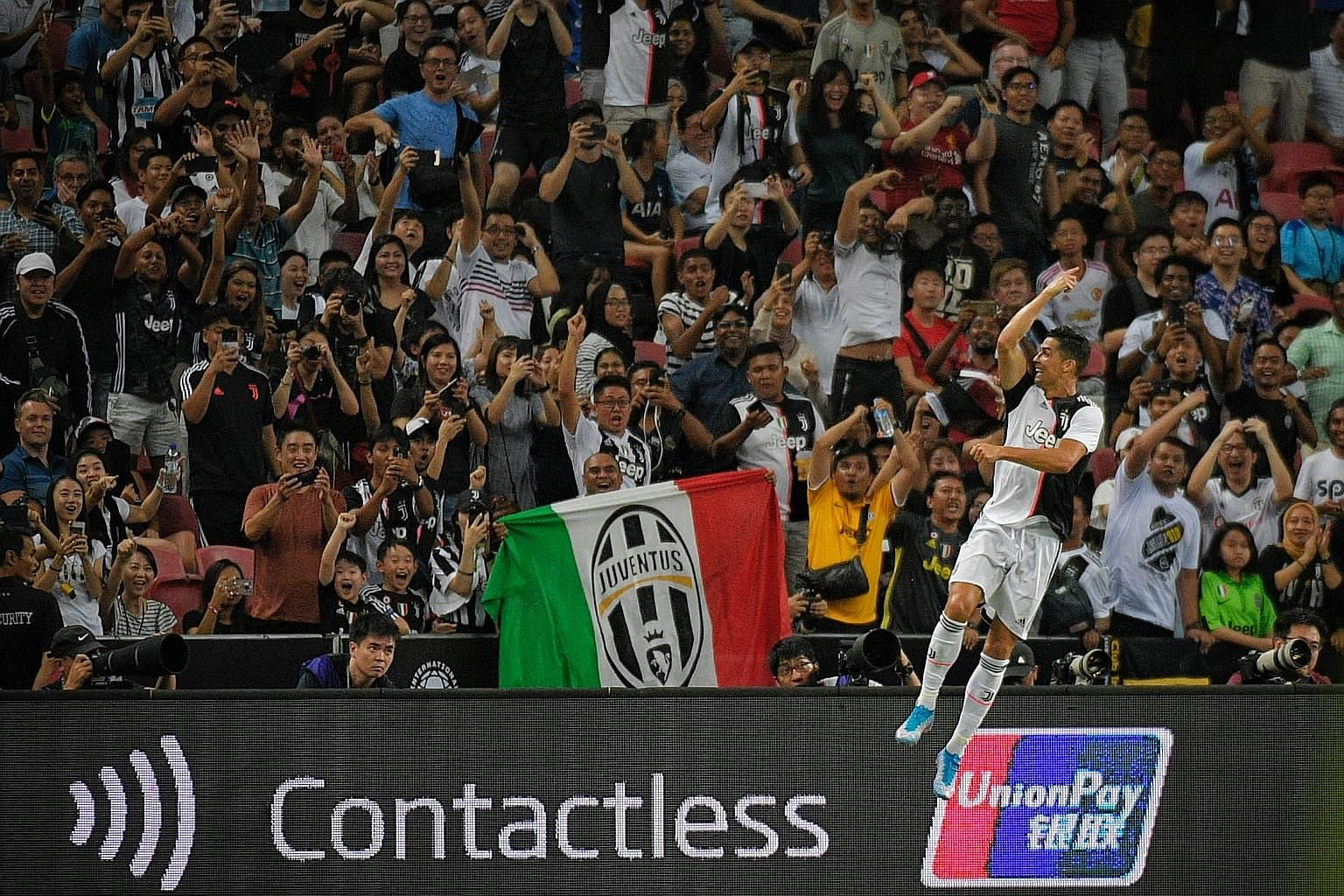 Juventus fans cheer as Portuguese superstar Cristiano Ronaldo does his trademark celebration after scoring against Tottenham during the International Champions Cup match at the National Stadium last night.